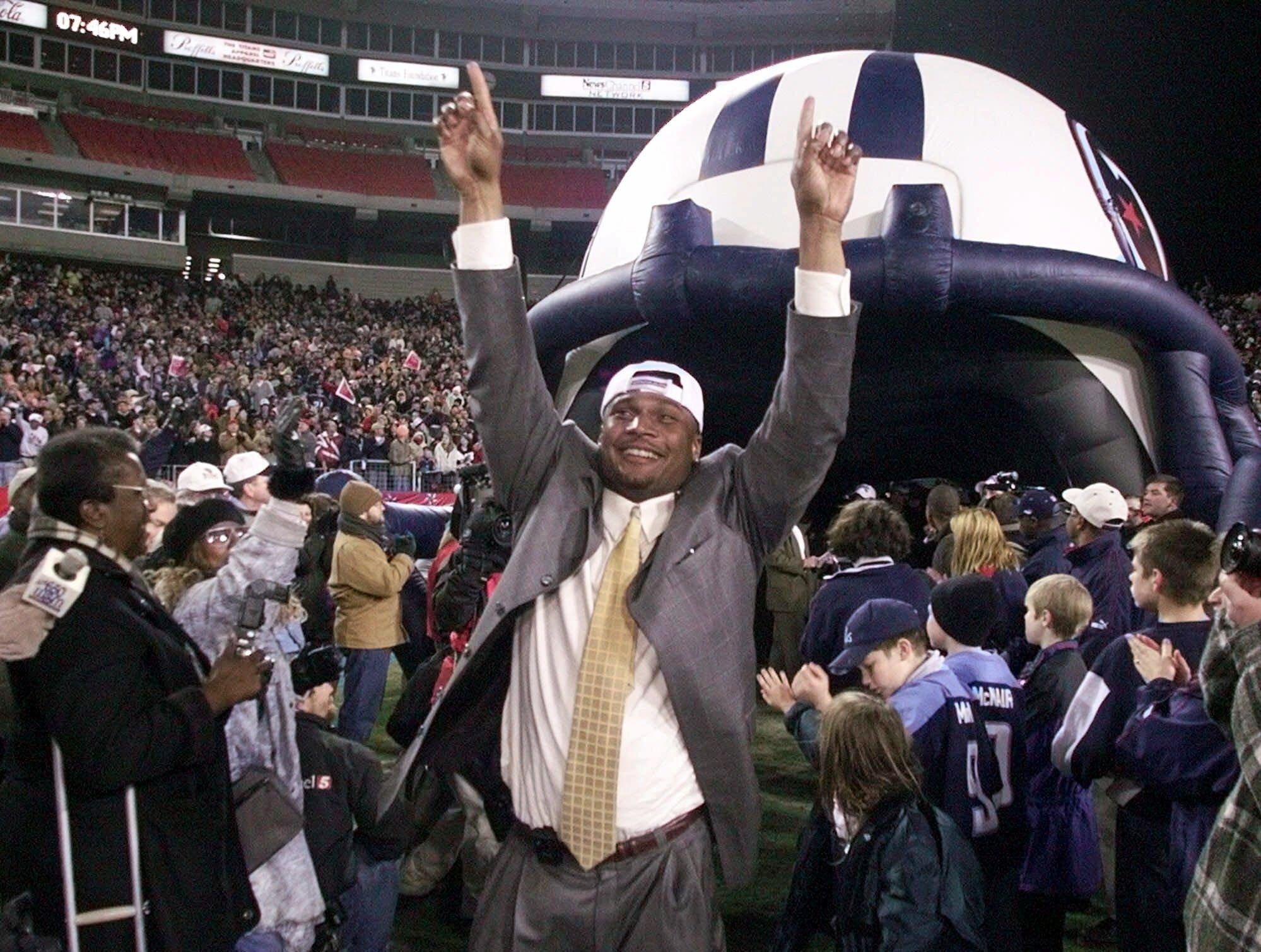 Tennessee Titans quarterback Steve McNair reacts to the roar of 43,000 Titans fans Jan. 23, 2000 as the team returned to Adelphia Coliseum in Nashville after defeating the Jacksonville Jaguars 33-14 to win the AFC championship.