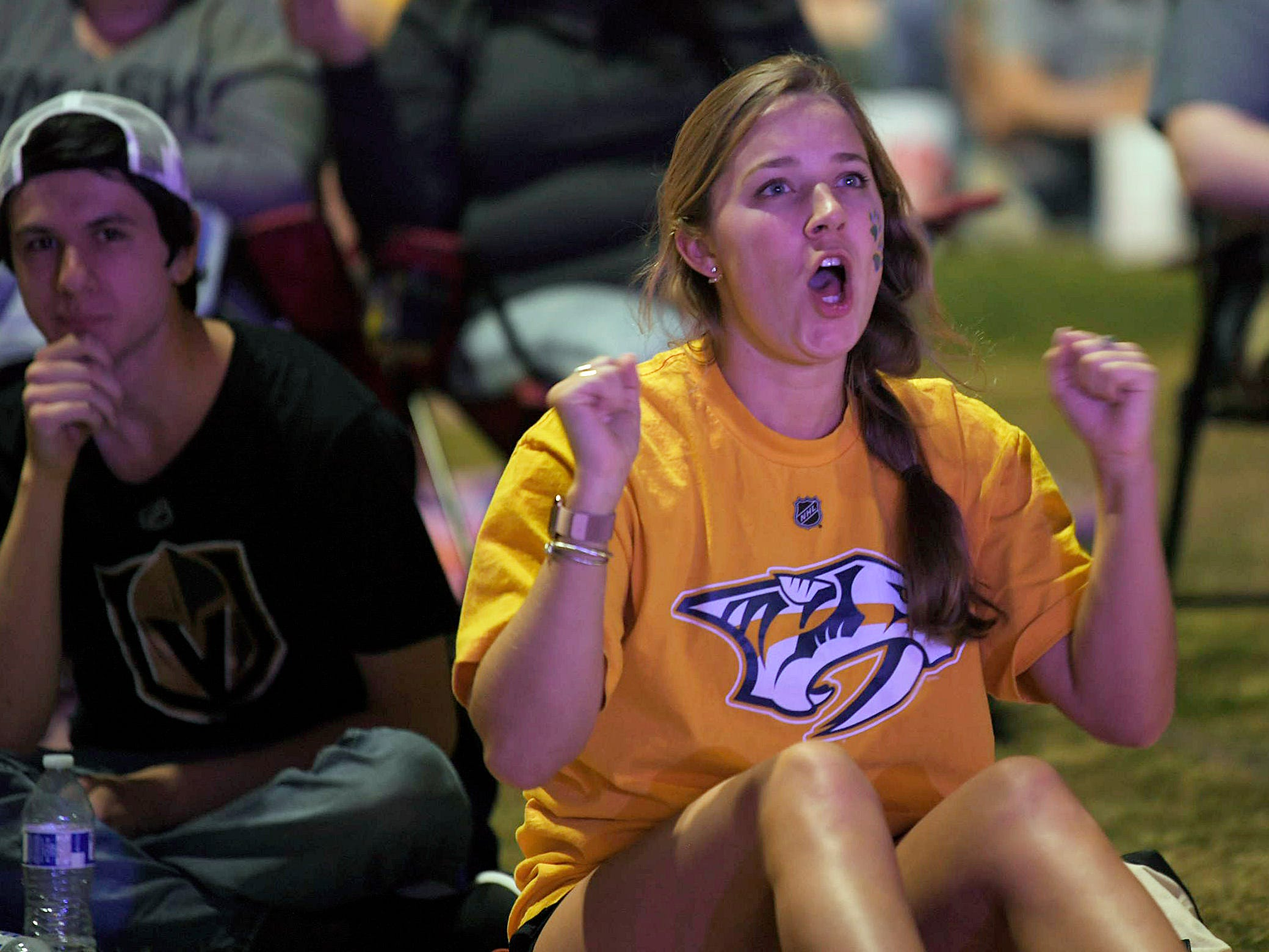 Predators fan Julia Fleming watches the game at Preds Party in the Park at Walk of Fame Park in Nashville on Wednesday, April 10, 2019.