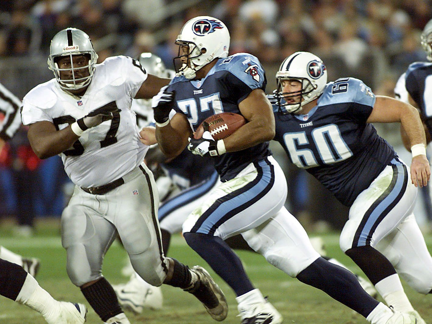 Tennessee Titans running back Eddie George (27) runs the ball during their 21-14 victory over the Oakland Raiders at the Adelpha Coliseum in Nashville Dec. 9, 1999.