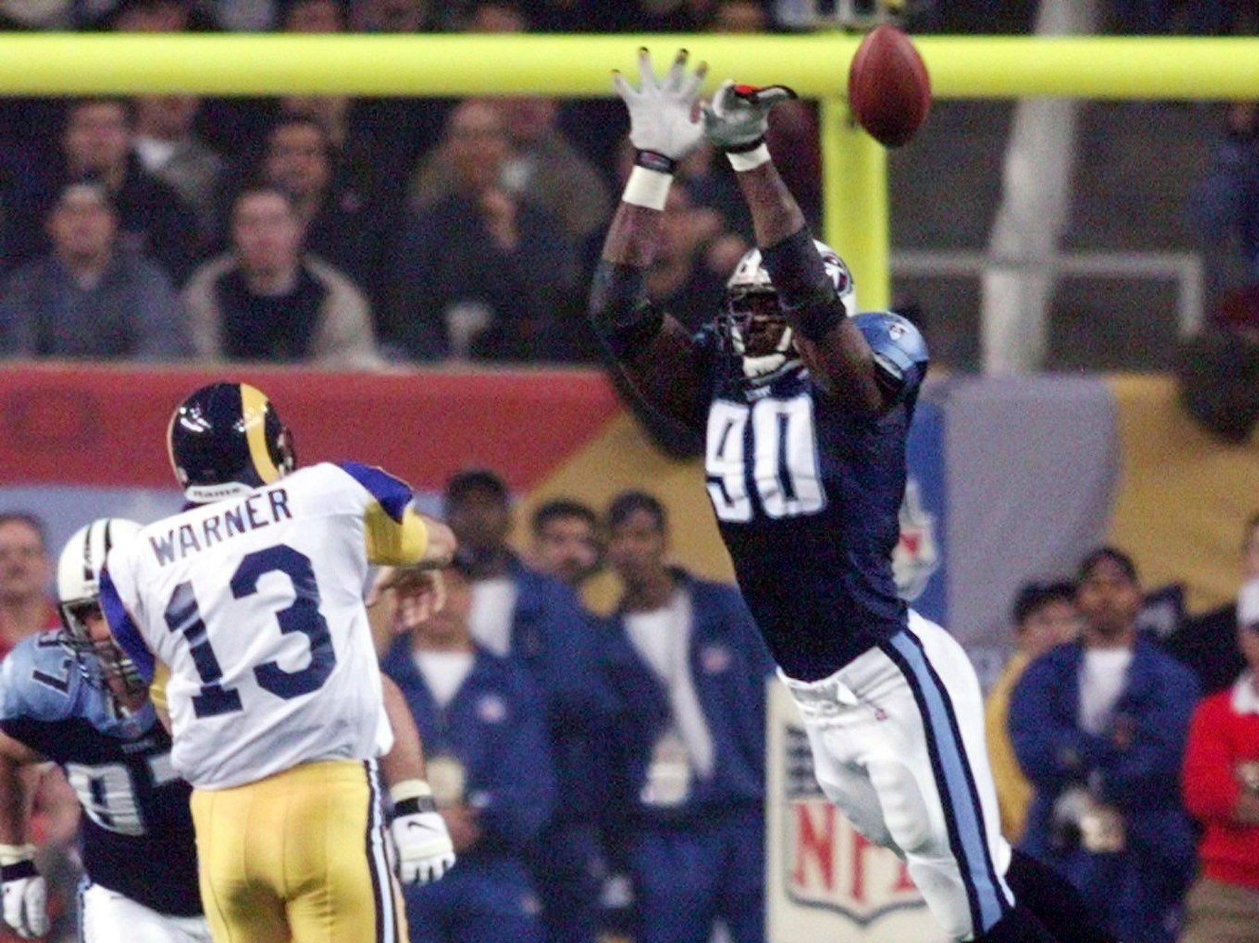 Tennessee Titans defensive end Jevon Kearse (90) blocks a pass by St. Louis Rams quarterback Kurt Warner during the 3rd quarter Jan. 30, 2000. The Titans just fell inches short in a 23-16 Rams' victory in Super Bowl XXXIV.