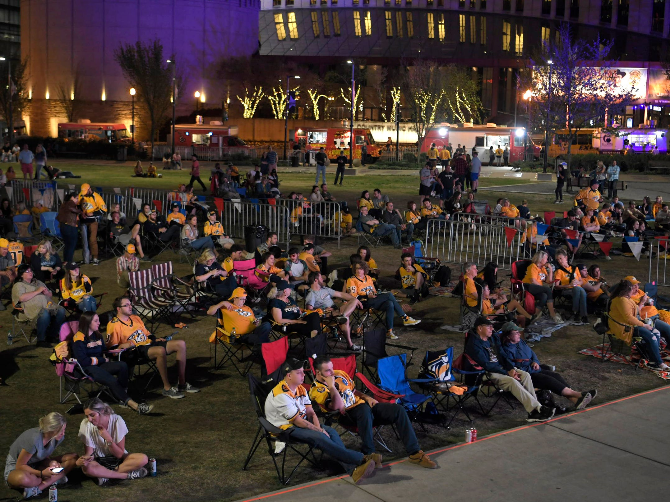 Predators fans gather to watch the game at Preds Party in the Park at Walk of Fame Park in Nashville on Wednesday, April 10, 2019.