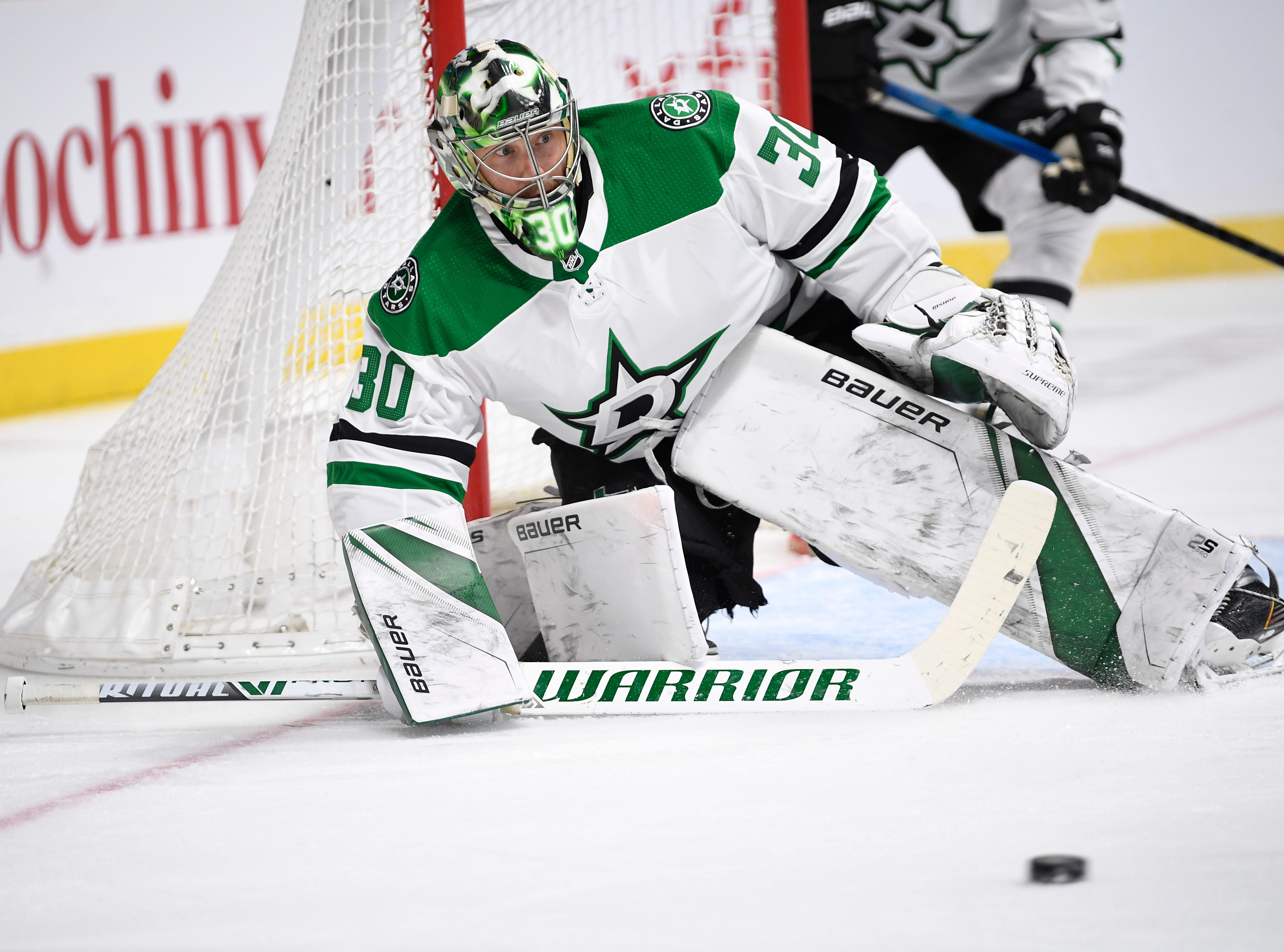 Dallas Stars goaltender Ben Bishop (30) keeps an eye on the puck during the first period of the divisional semifinal game against the Nashville Predators at Bridgestone Arena in Nashville, Tenn., Wednesday, April 10, 2019.