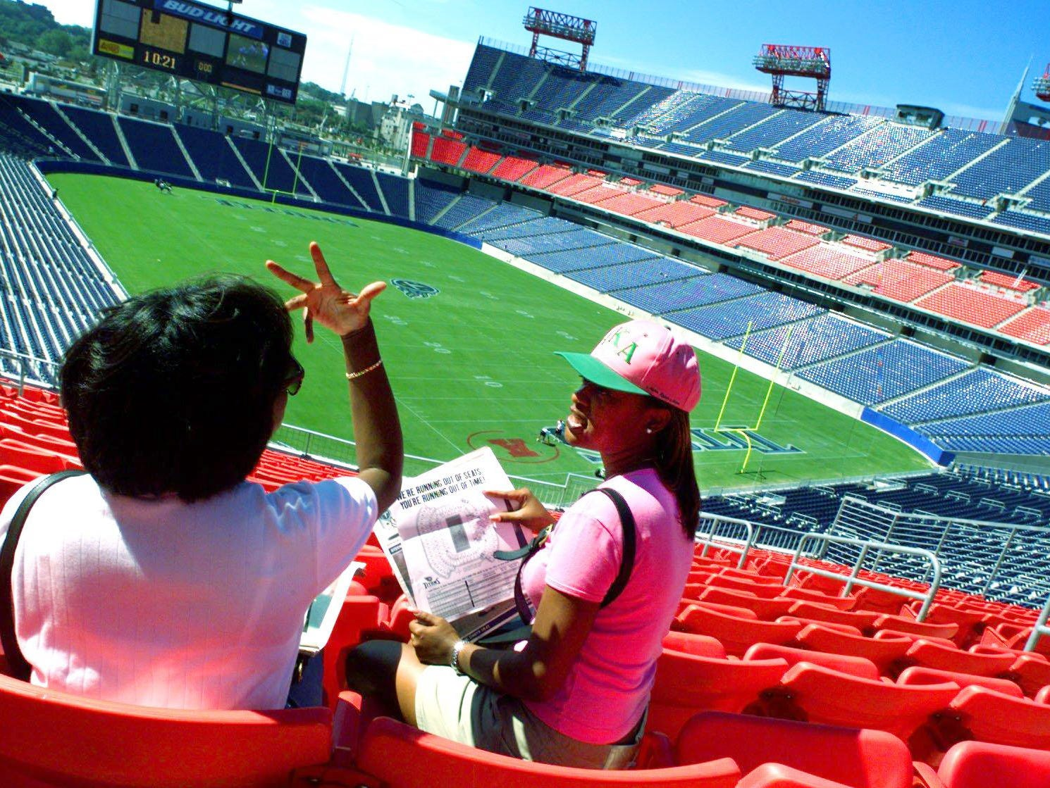 Angela Sumbry, left, and her friend LaShai Watson try out some seats in the club level at the Adelphia Coliseum Aug. 21, 1999. Private Seat Licenses are still available and the Titans are having a tag sale. A tag is put on the seats that are still up for grabs and shoppers get to find the seat they want, try it out, and then purchase it on the spot.