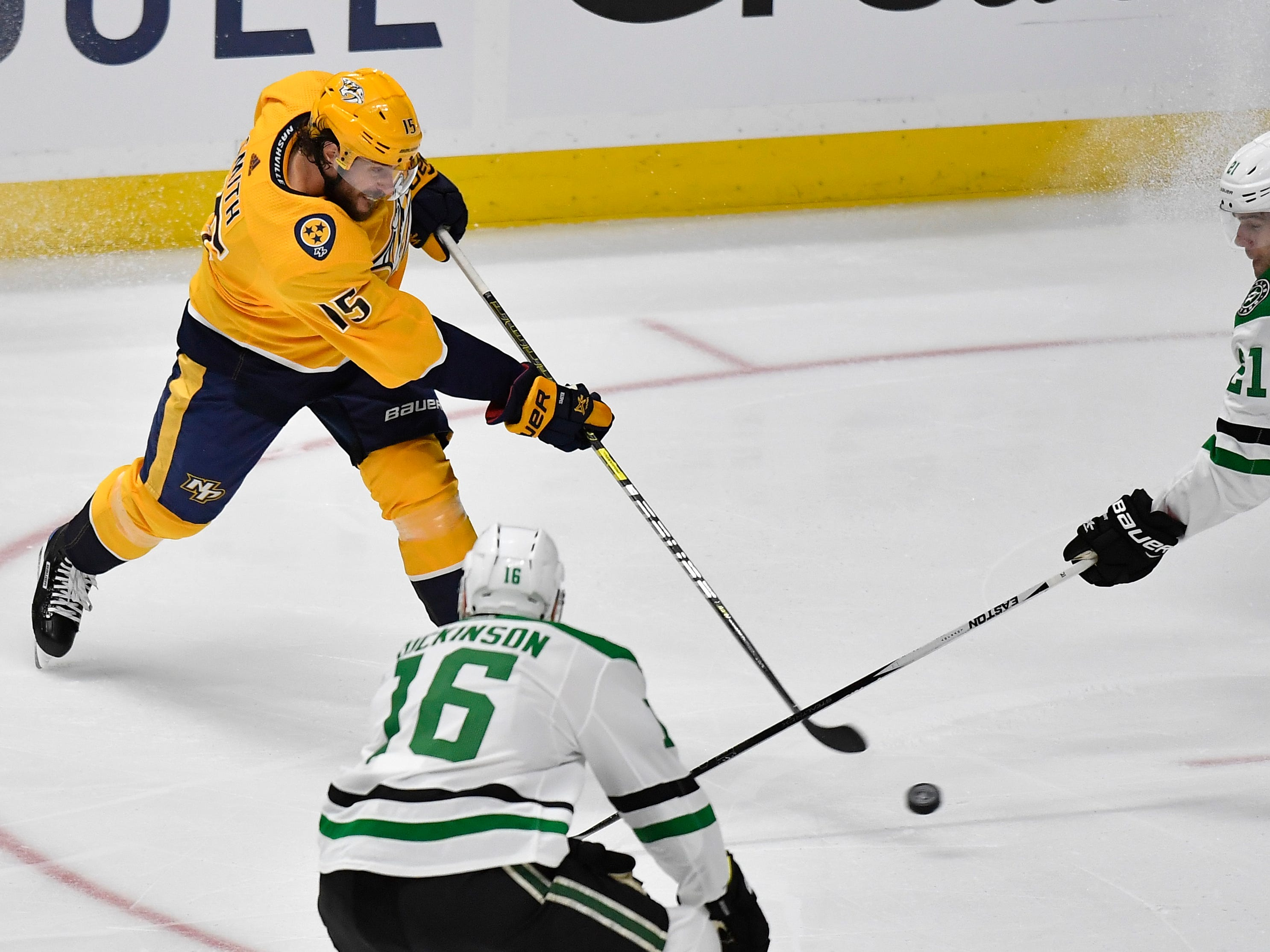 Nashville Predators right wing Craig Smith (15) moves the puck defended by Dallas Stars defenseman Ben Lovejoy (21) during the first period of the divisional semifinal game at Bridgestone Arena in Nashville, Tenn., Wednesday, April 10, 2019.