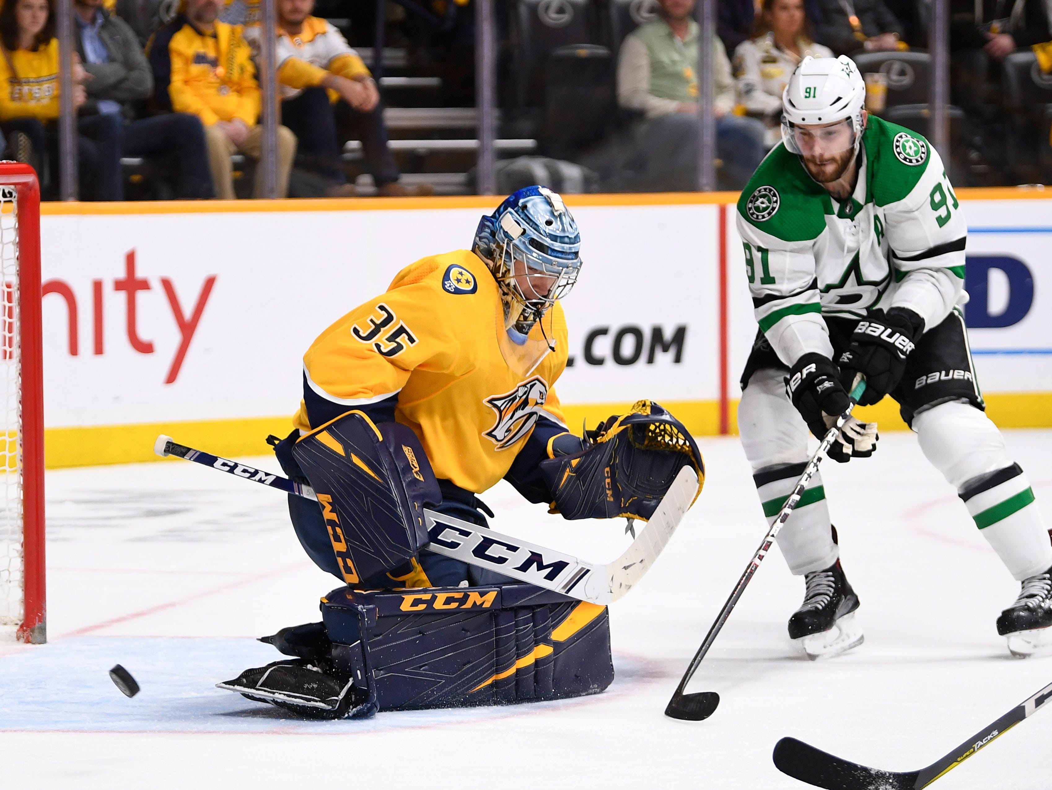 Nashville Predators goaltender Pekka Rinne (35) and Dallas Stars center Tyler Seguin (91) watch the puck go wide during the second period of the divisional semifinal game at Bridgestone Arena in Nashville, Tenn., Wednesday, April 10, 2019.