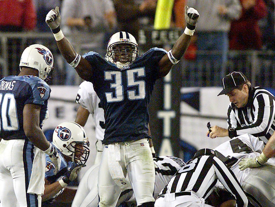 Tennessee Titans safety Perry Phoenix (35) celebrates a fumble recovery on a punt return in the 4th quarter that clenched the Titans 21-14 victory over the Oakland Raiders at the Adelpha Coliseum in Nashville Dec. 9, 1999.