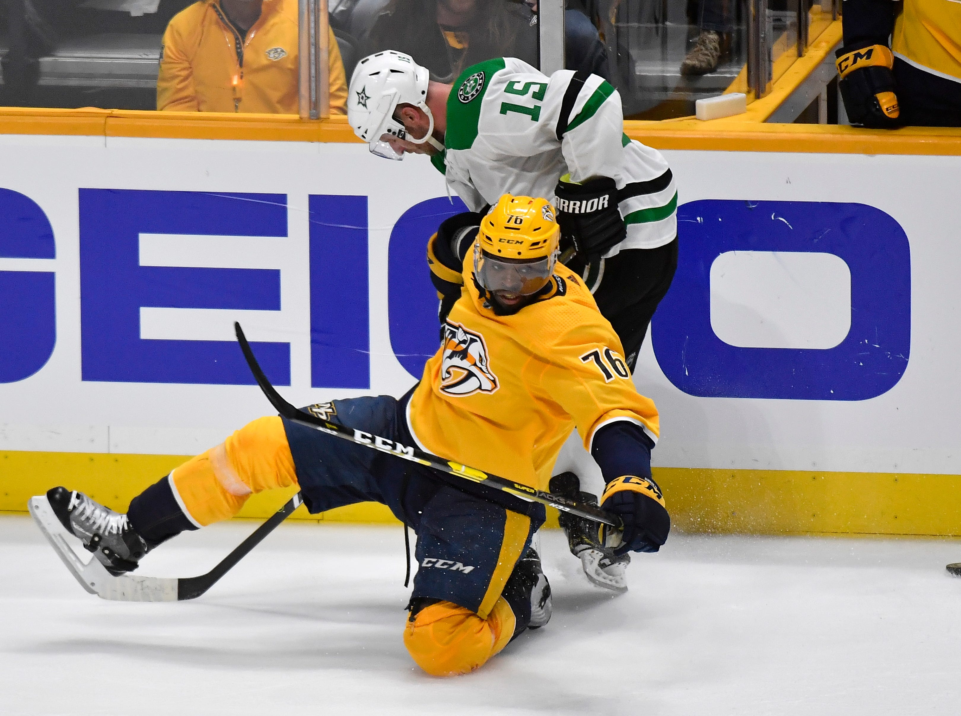 Nashville Predators defenseman P.K. Subban (76) and Dallas Stars left wing Blake Comeau (15) battle for the puck during the third period of the divisional semifinal game at Bridgestone Arena in Nashville, Tenn., Wednesday, April 10, 2019.