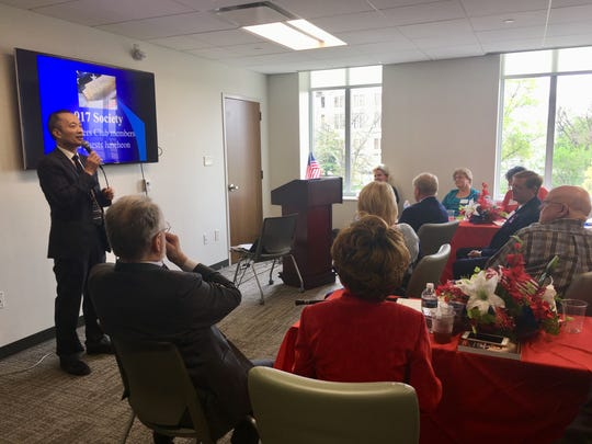Dr. Ming Wang speaks during the 917 Society Annual Founders Day Luncheon on April 11, 2019.