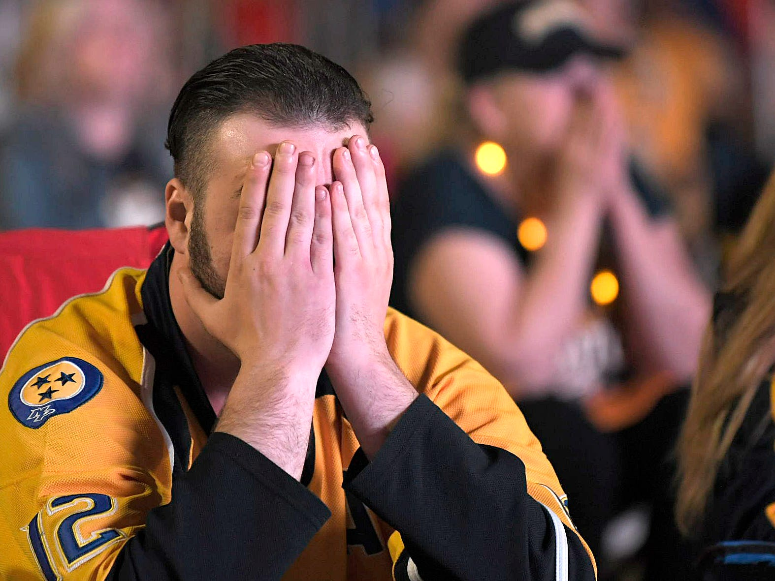Predator fan  Zachary Kirby reacts to the hockey game against Dallas at the Preds Party in the Park at Walk of Fame Park in Nashville on Wednesday, April 10, 2019. Predators lost to Dallas 2-3.