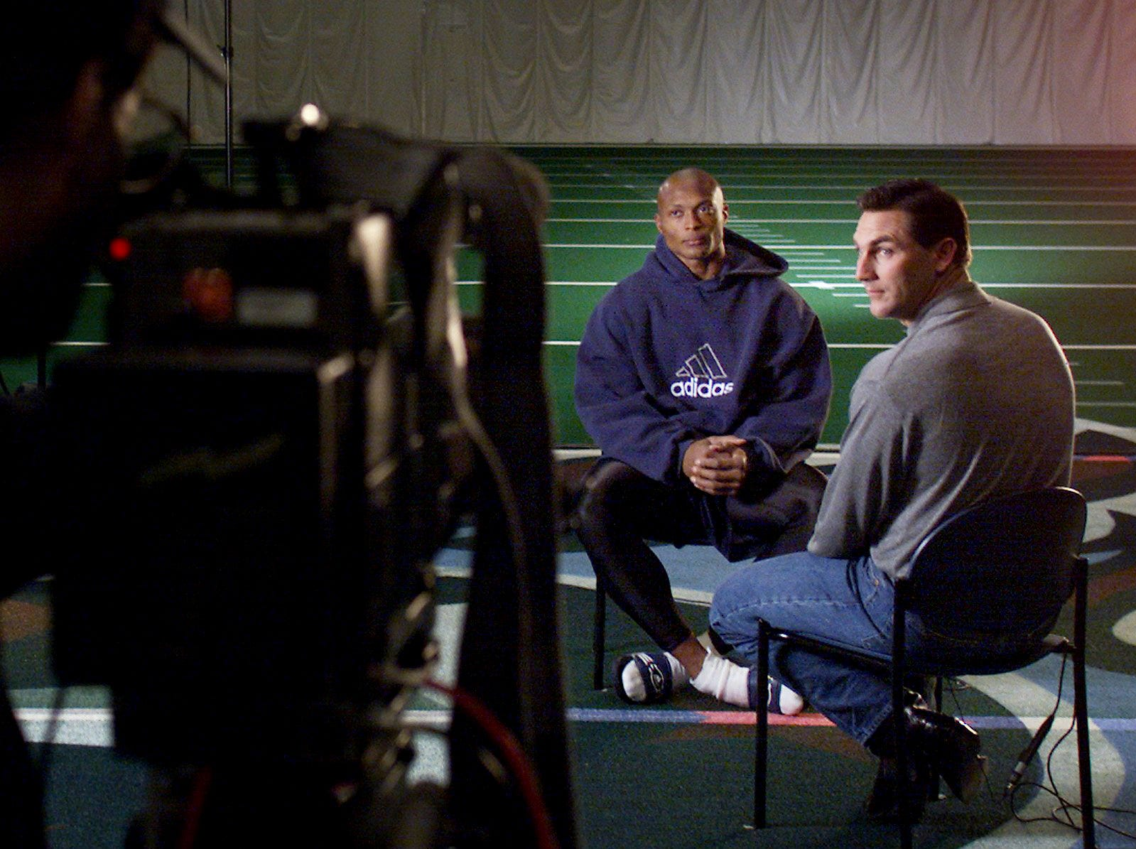 Eddie George of the Tennessee Titans does an interview with Craig James, right, from the NFL on CBS crew following practice Jan. 19, 2000 as the Titans prepare to face the Jacksonville Jaguars in the AFC championship game.
