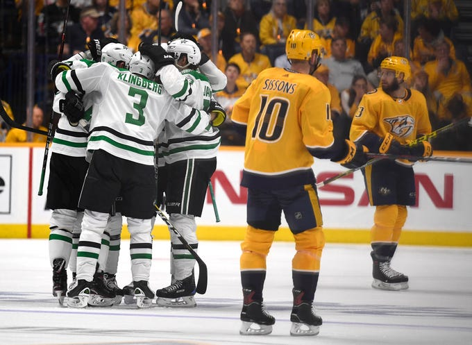 The Stars celebrate the second goal by defenseman Miro Heiskanen (4) as Nashville Predators centers Colton Sissons (10) and Nick Bonino (13) look away during the third period of the divisional semifinal game at Bridgestone Arena in Nashville, Tenn., Wednesday, April 10, 2019.