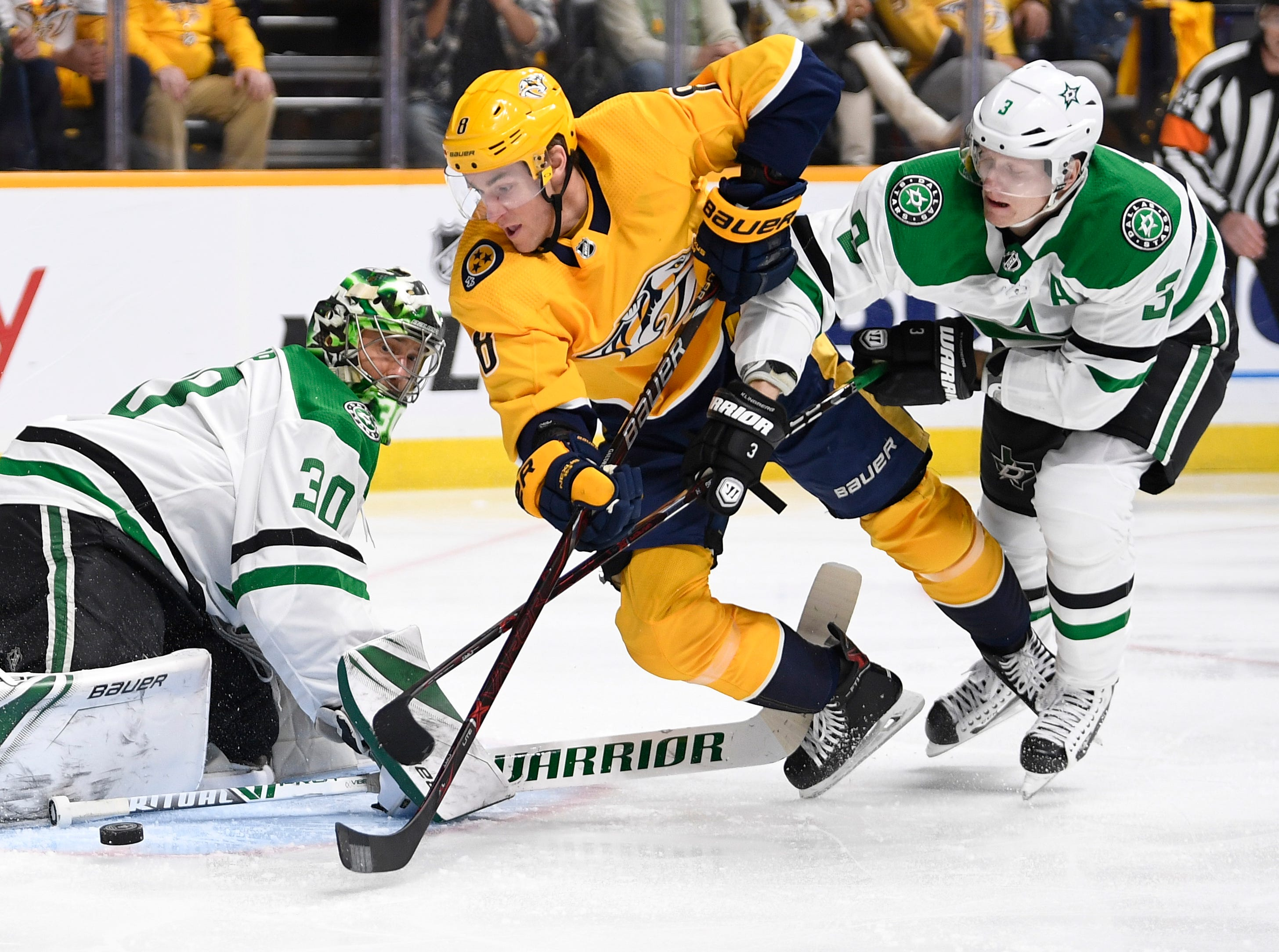 Nashville Predators center Kyle Turris (8) battles for the puck with Dallas Stars defenseman John Klingberg (3) in front of Dallas Stars goaltender Ben Bishop (30) during the first period of the divisional semifinal game at Bridgestone Arena in Nashville, Tenn., Wednesday, April 10, 2019.