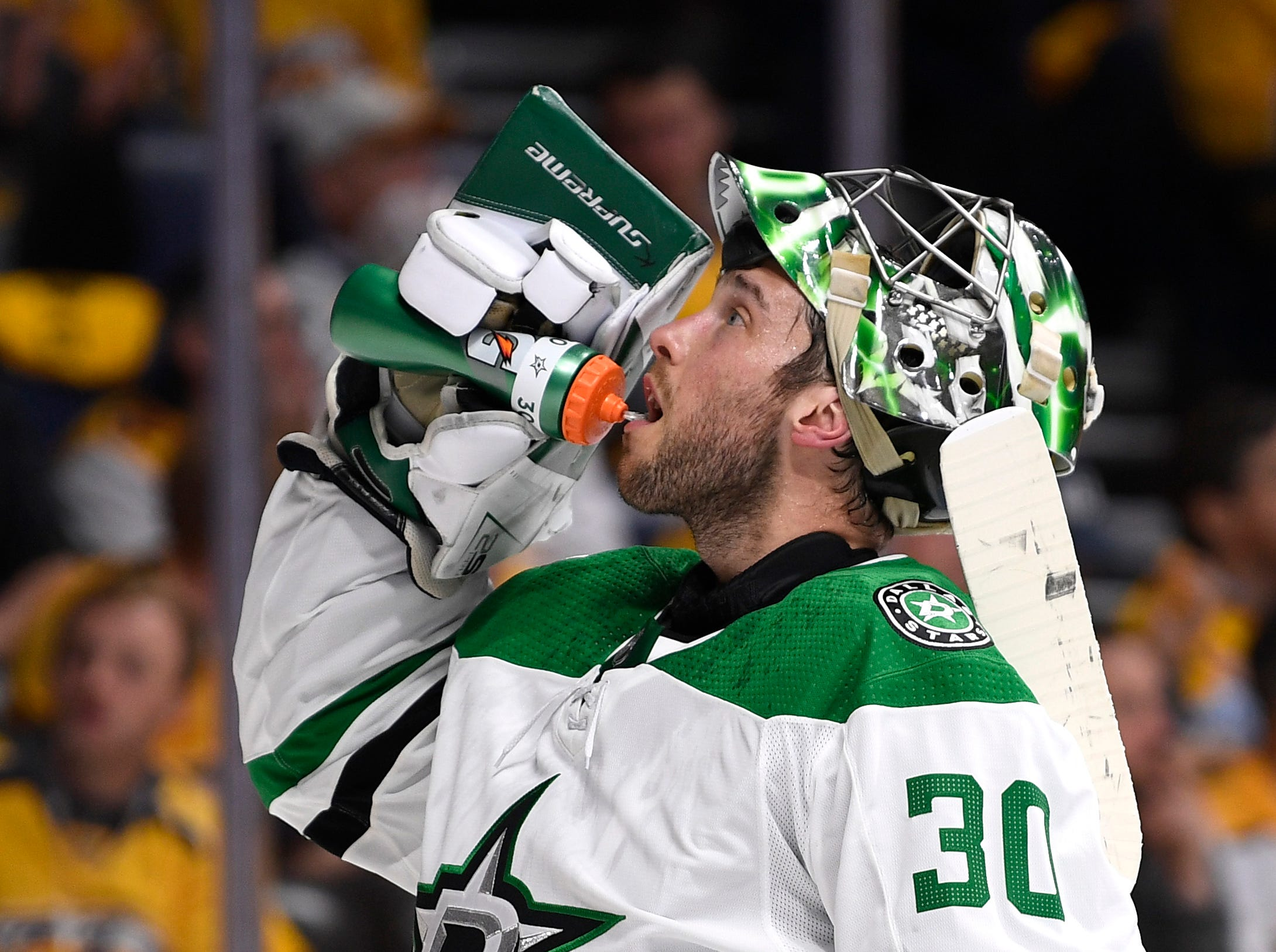 Dallas Stars goaltender Ben Bishop (30) takes a drink during a break in the first period of the divisional semifinal game at Bridgestone Arena in Nashville, Tenn., Wednesday, April 10, 2019.