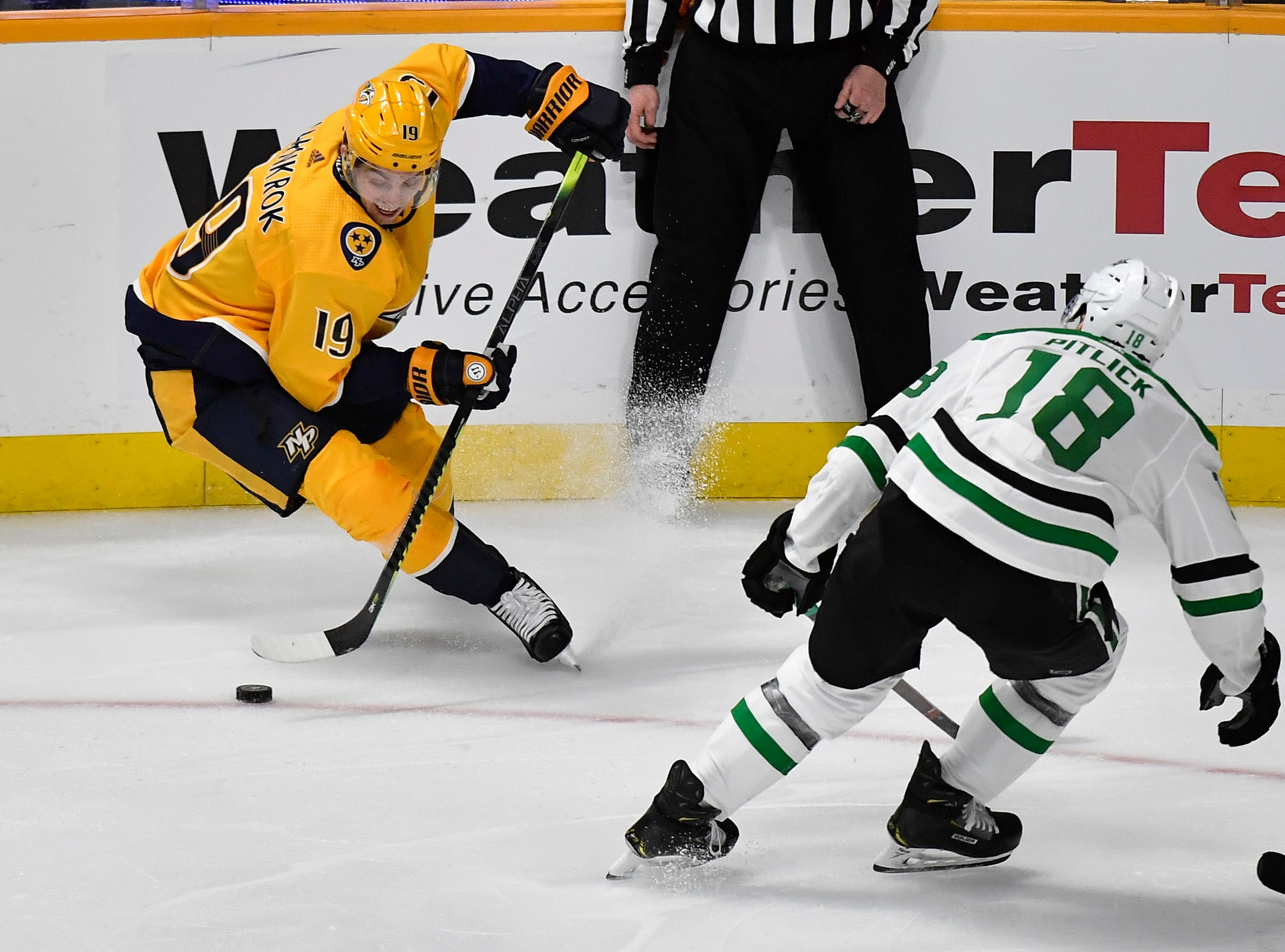 Nashville Predators center Calle Jarnkrok (19) moves the puck defended by Dallas Stars center Tyler Pitlick (18) during the first period of the divisional semifinal game at Bridgestone Arena in Nashville, Tenn., Wednesday, April 10, 2019.