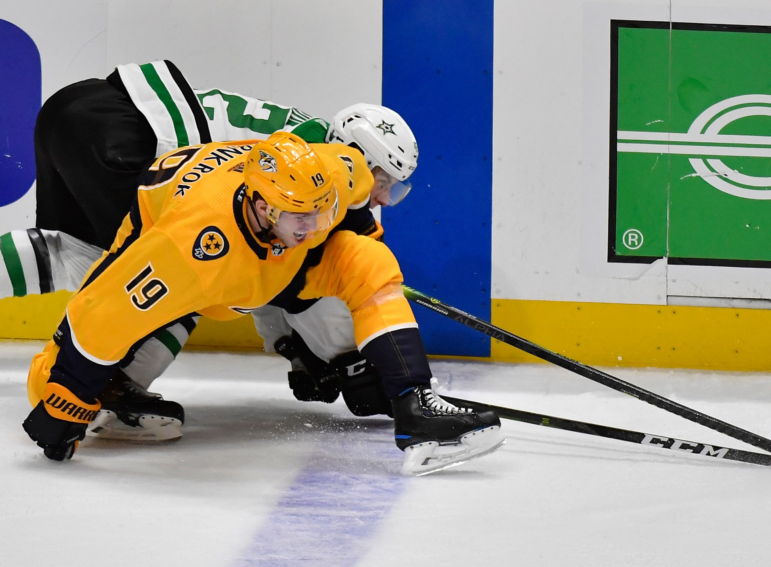 Nashville Predators center Calle Jarnkrok (19) and Dallas Stars defenseman Taylor Fedun (42) battle for the puck during the second period of the divisional semifinal game at Bridgestone Arena in Nashville, Tenn., Wednesday, April 10, 2019.
