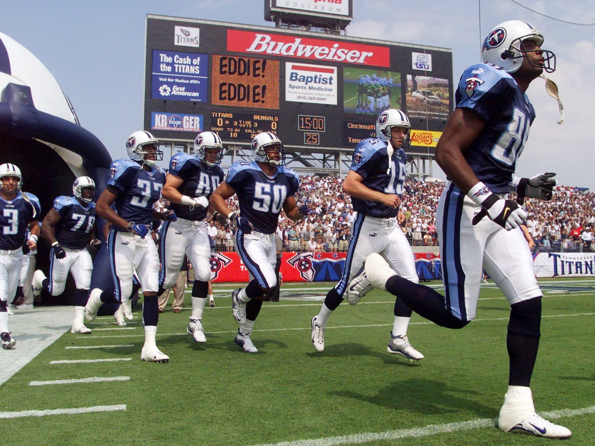 Tennessee Titans wide receiver Joey Kent, right, and his teammates run on to the field for their season-opening game against the Cincinnati Bengals at their new Adelphia Coliseum in Nashville Sept. 12, 1999. The Titans defeated the Bengals, 36-35.