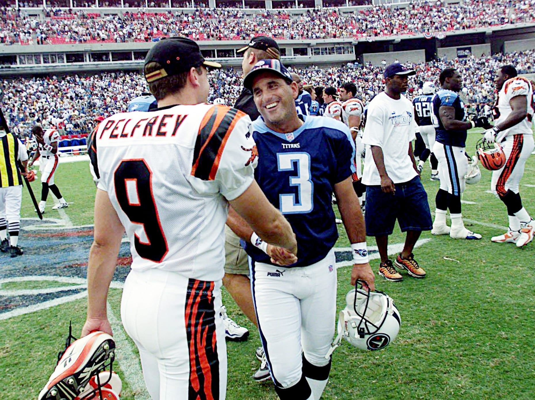 Tennessee Titans place kicer Al Del Greco (3) is being congratules by Cincinnati Bengals kicker Doug Pelfrey (9) after Del Greco winning kick made the final score 36-35 in the season opener at Adelphia Coliseum Sept. 12, 1999.