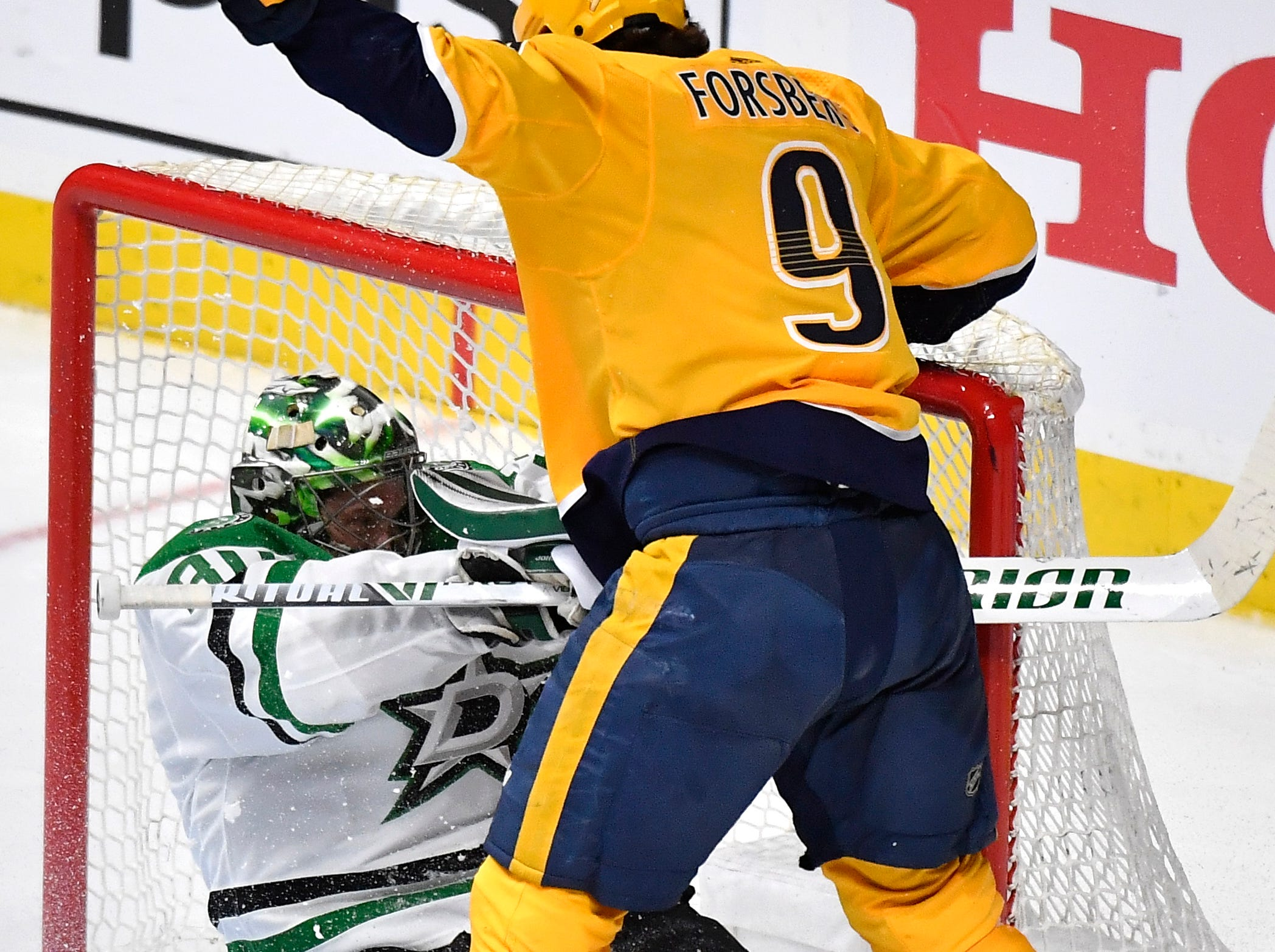 Nashville Predators left wing Filip Forsberg (9) and Dallas Stars goaltender Ben Bishop (30) collide during the third period of the divisional semifinal game at Bridgestone Arena in Nashville, Tenn., Wednesday, April 10, 2019.