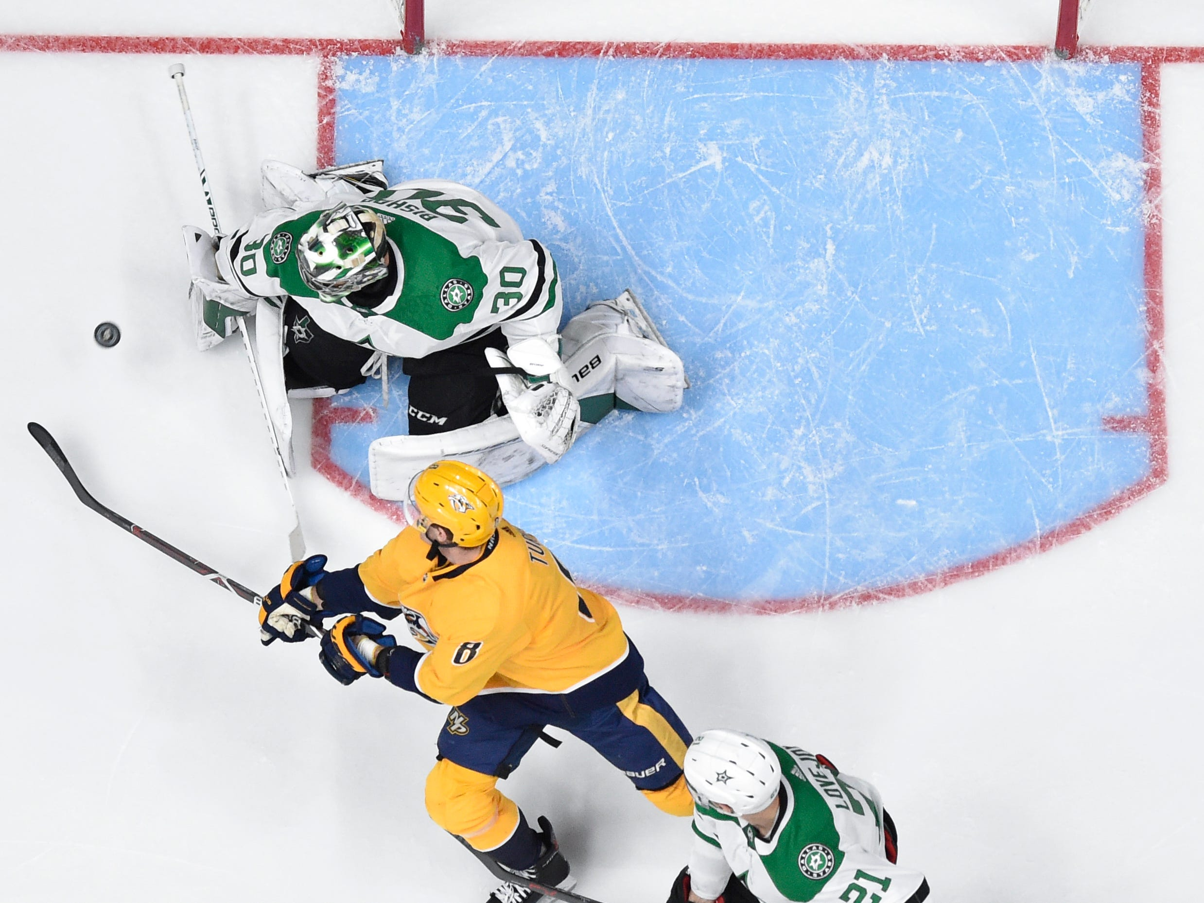 Dallas Stars goaltender Ben Bishop (30) and defenseman Ben Lovejoy (21) defend against Nashville Predators center Kyle Turris (8) during the second period of the divisional semifinal game at Bridgestone Arena in Nashville, Tenn., Wednesday, April 10, 2019.