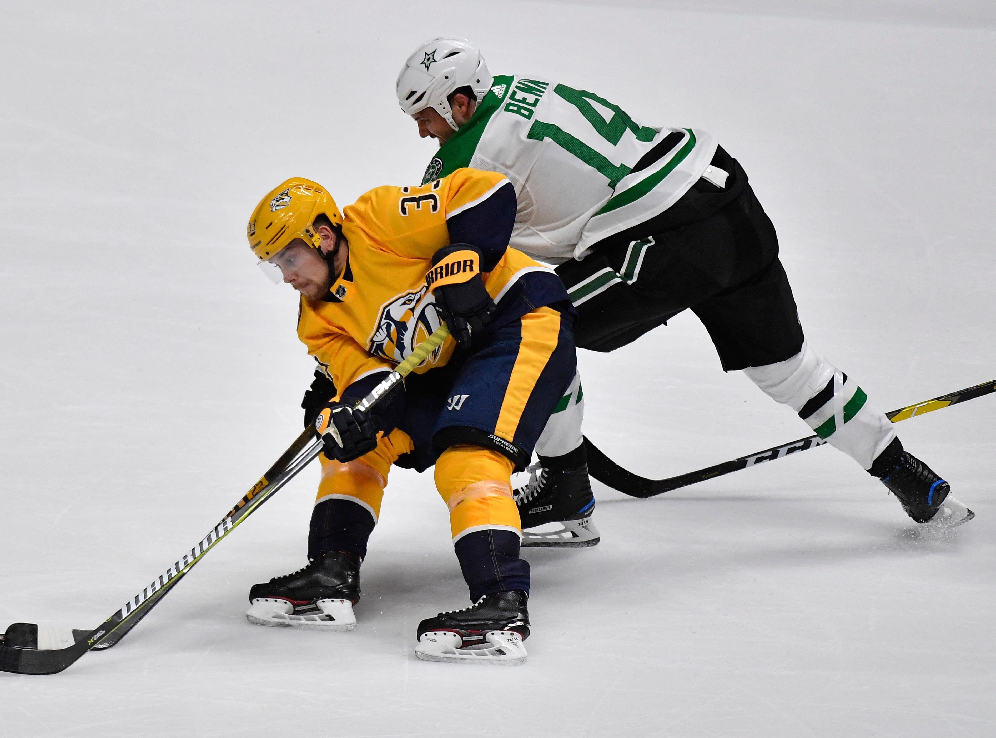 Nashville Predators right wing Viktor Arvidsson (33) and Dallas Stars left wing Jamie Benn (14) battle for the puck during the second period of the divisional semifinal game at Bridgestone Arena in Nashville, Tenn., Wednesday, April 10, 2019.