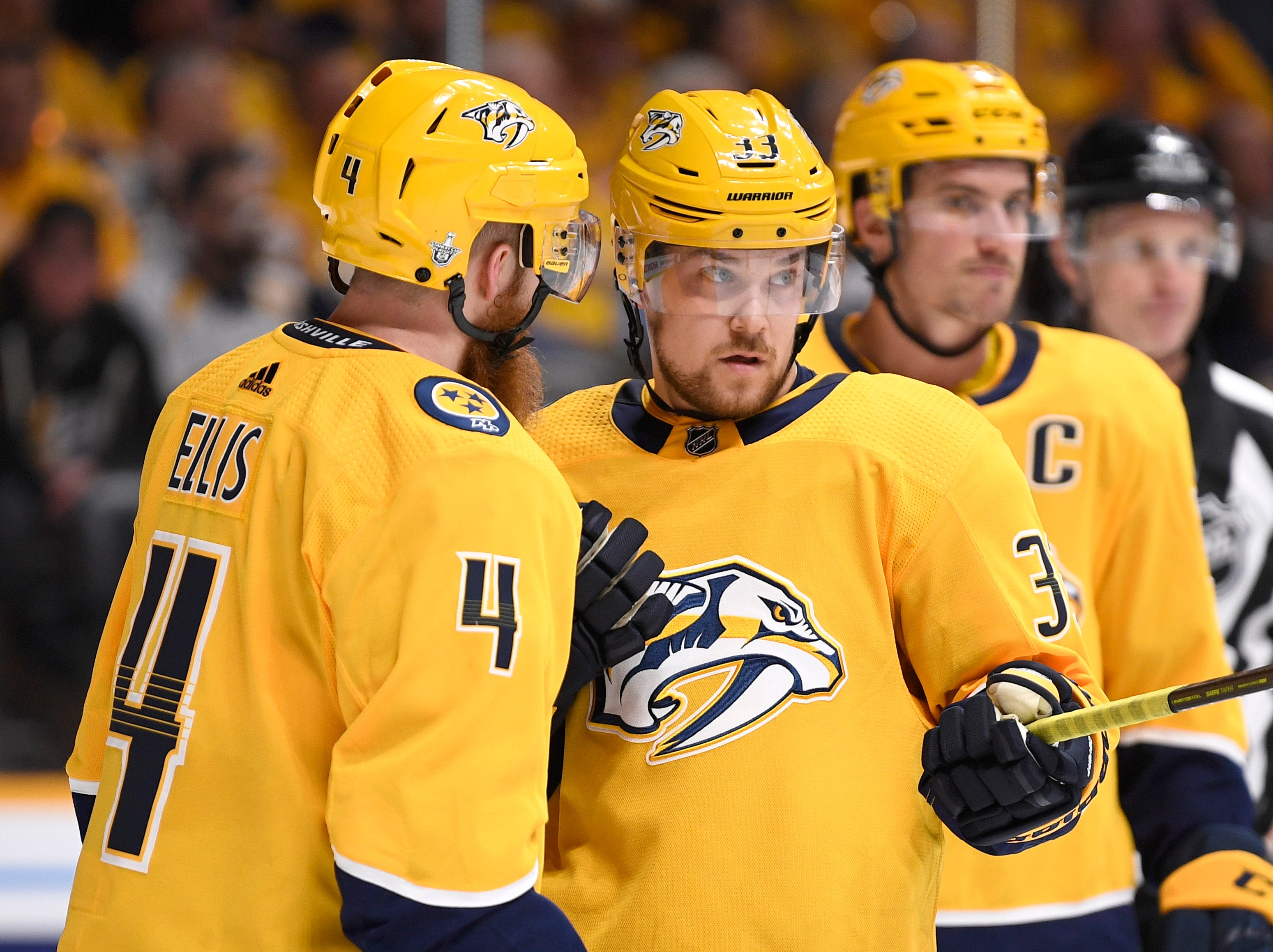 Nashville Predators defenseman Ryan Ellis (4) and right wing Viktor Arvidsson (33) confer during a break in the second period of the divisional semifinal game at Bridgestone Arena in Nashville, Tenn., Wednesday, April 10, 2019.