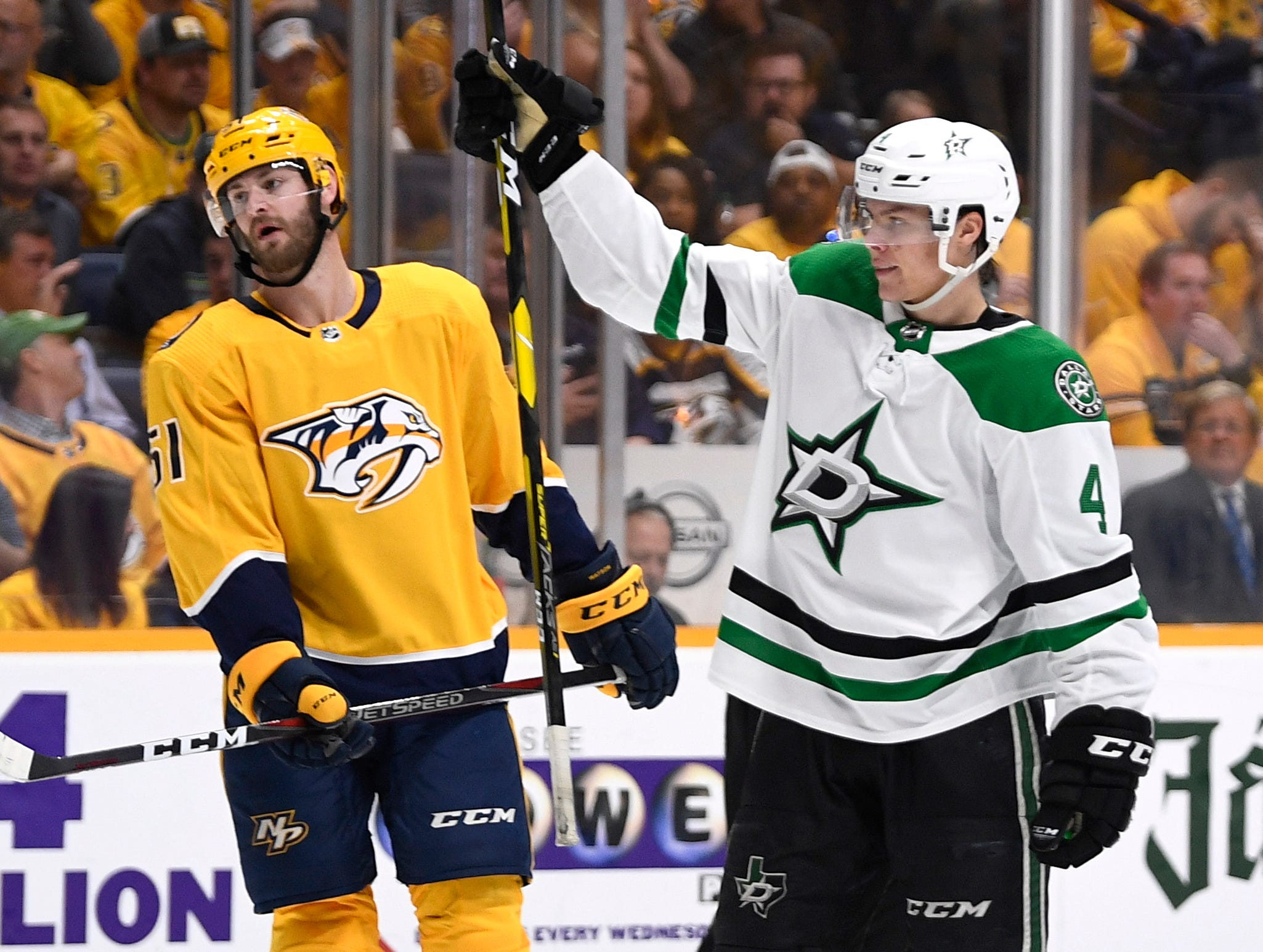 Dallas Stars defenseman Miro Heiskanen (4) celebrates his goal as Nashville Predators left wing Austin Watson (51) reacts during the second period of the divisional semifinal game at Bridgestone Arena in Nashville, Tenn., Wednesday, April 10, 2019.