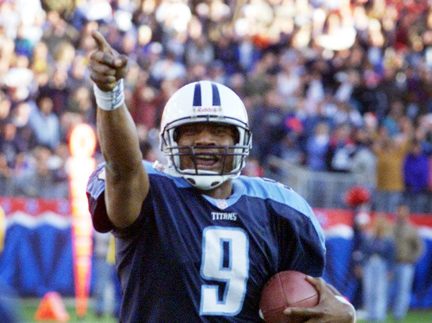Quarterback Steve McNair of the Tennessee Titans rushes into the end zone for a 3 yard touchdown run in the 4th quarter against the Atlanta Falcons at Adelphia Coliseum. Dec. 19, 1999.