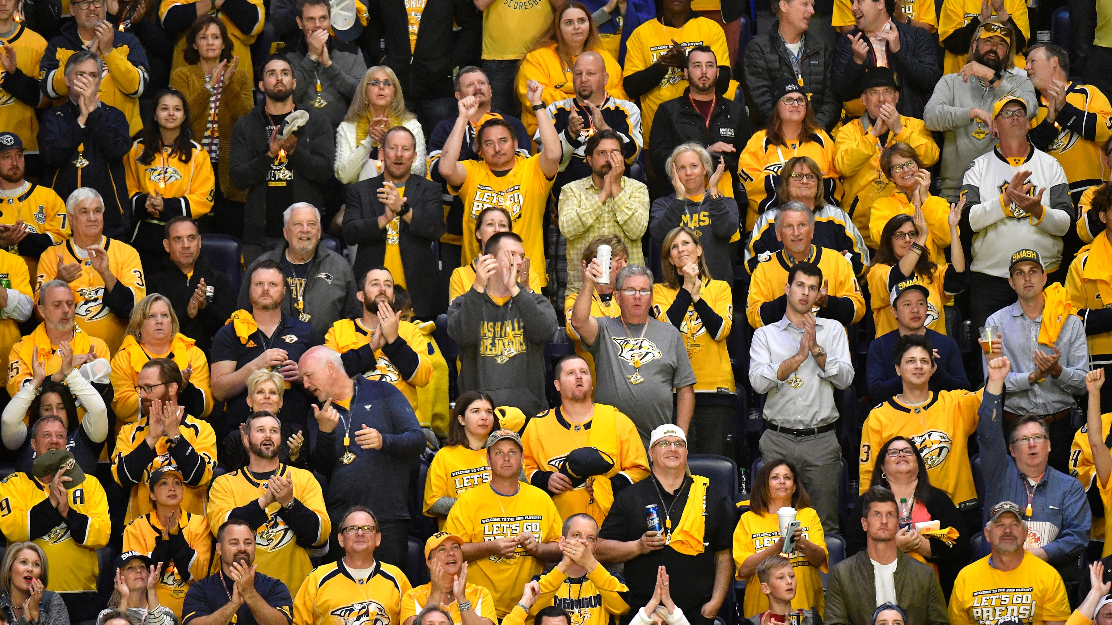 Predators fans cheer during the second period of the divisional semifinal game at Bridgestone Arena in Nashville, Tenn., Wednesday, April 10, 2019.