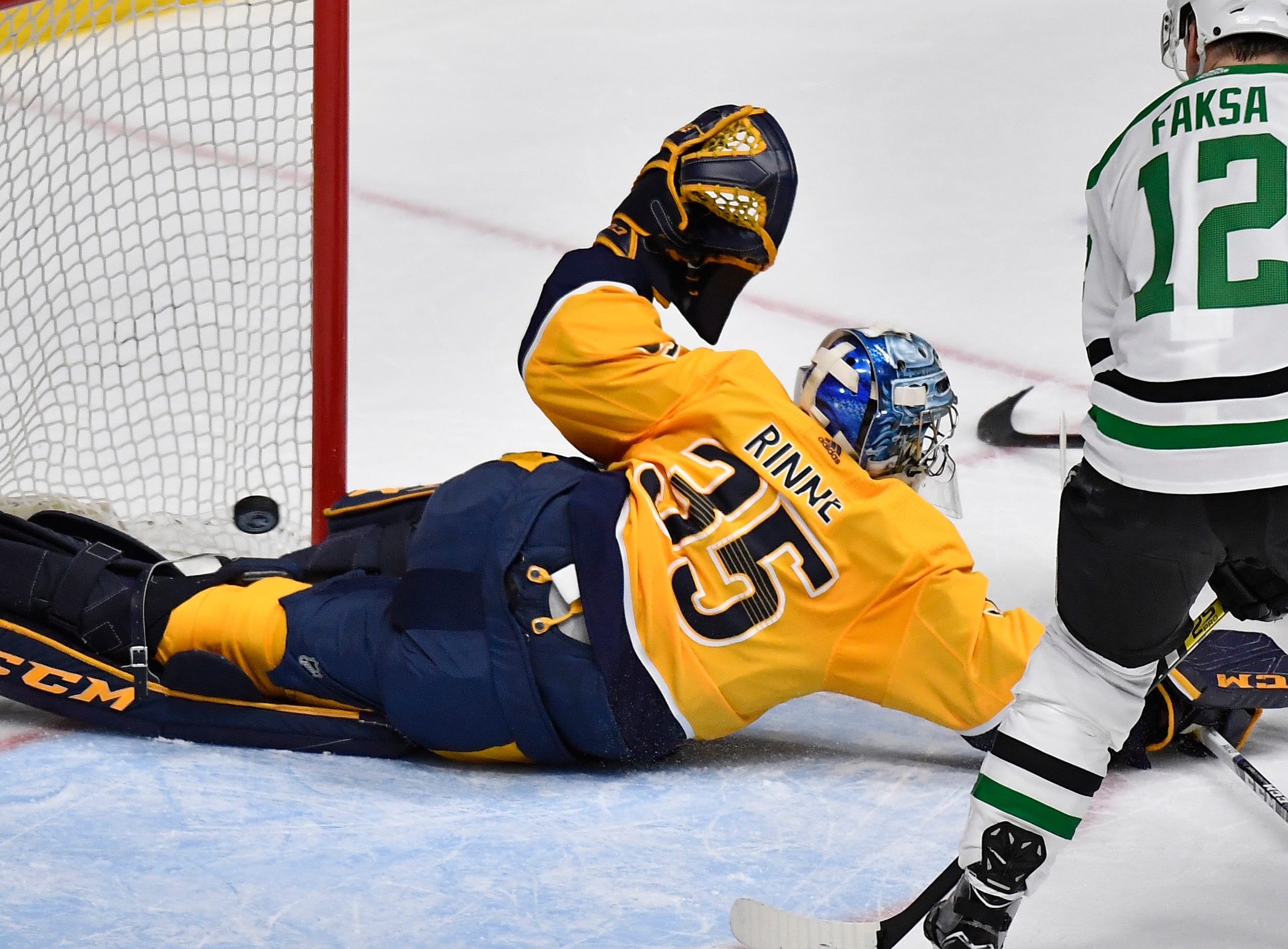 Nashville Predators goaltender Pekka Rinne (35) blocks a Dallas shot during the first period of the divisional semifinal game at Bridgestone Arena in Nashville, Tenn., Wednesday, April 10, 2019.