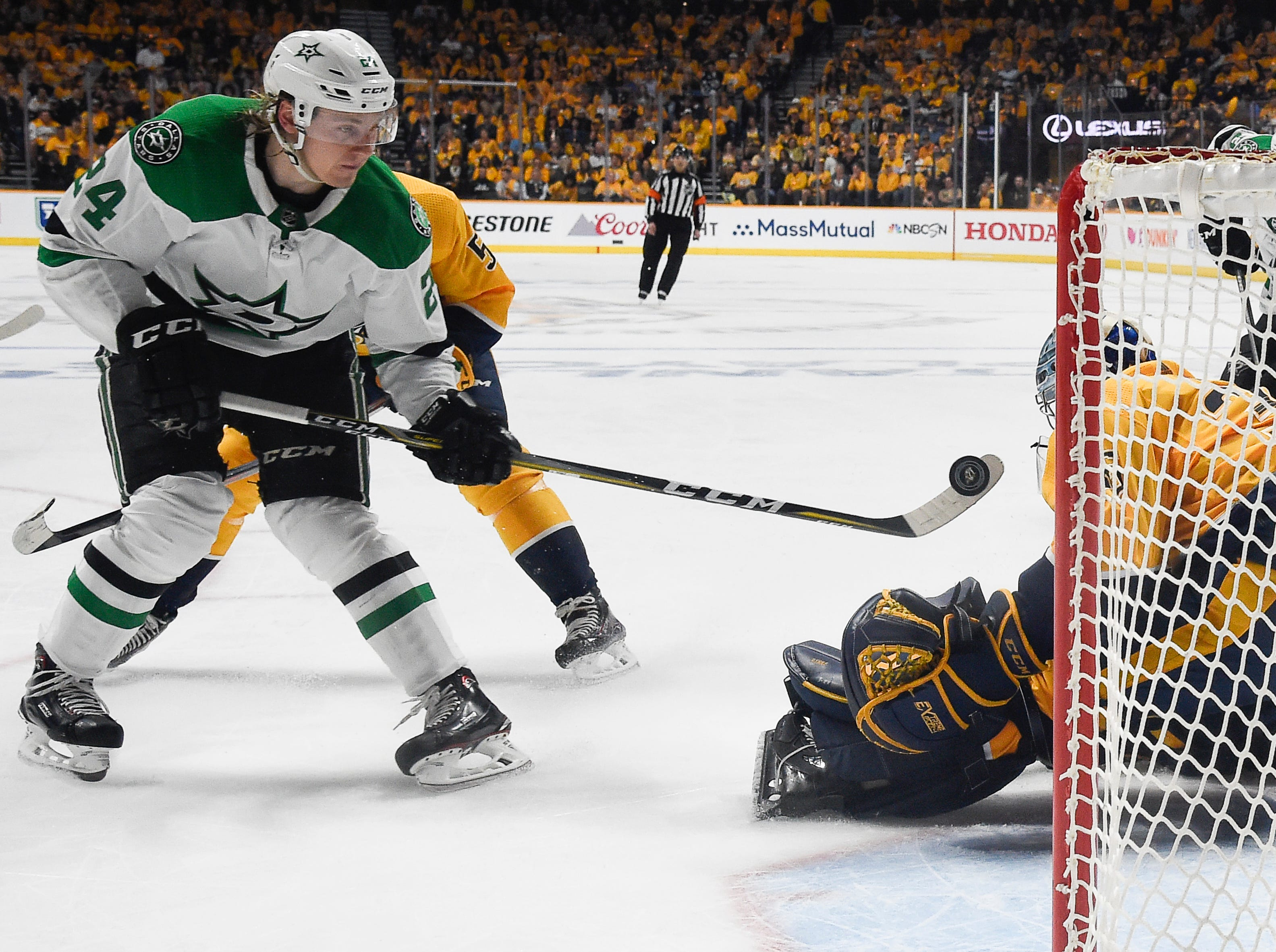 Dallas Stars left wing Roope Hintz (24) tries to shoot past Nashville Predators goaltender Pekka Rinne (35) during the second period of the divisional semifinal game at Bridgestone Arena Wednesday, April 10, 2019 in Nashville, Tenn.