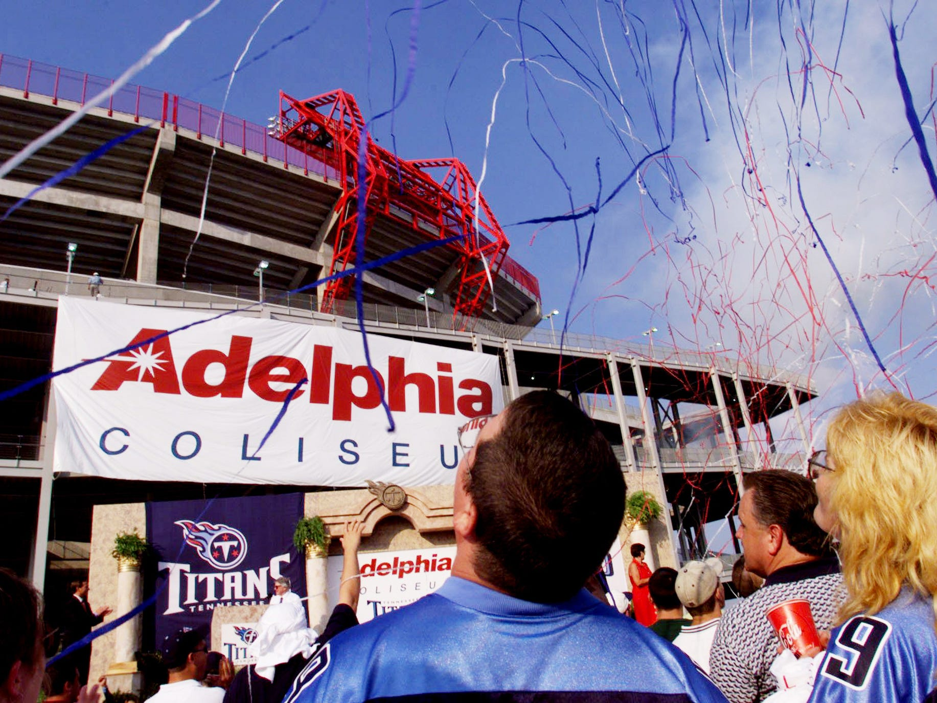 Fans watch as Tennessee Titans owner Bud Adams unveils the name of the Adelphia Coliseum July 8, 1999.