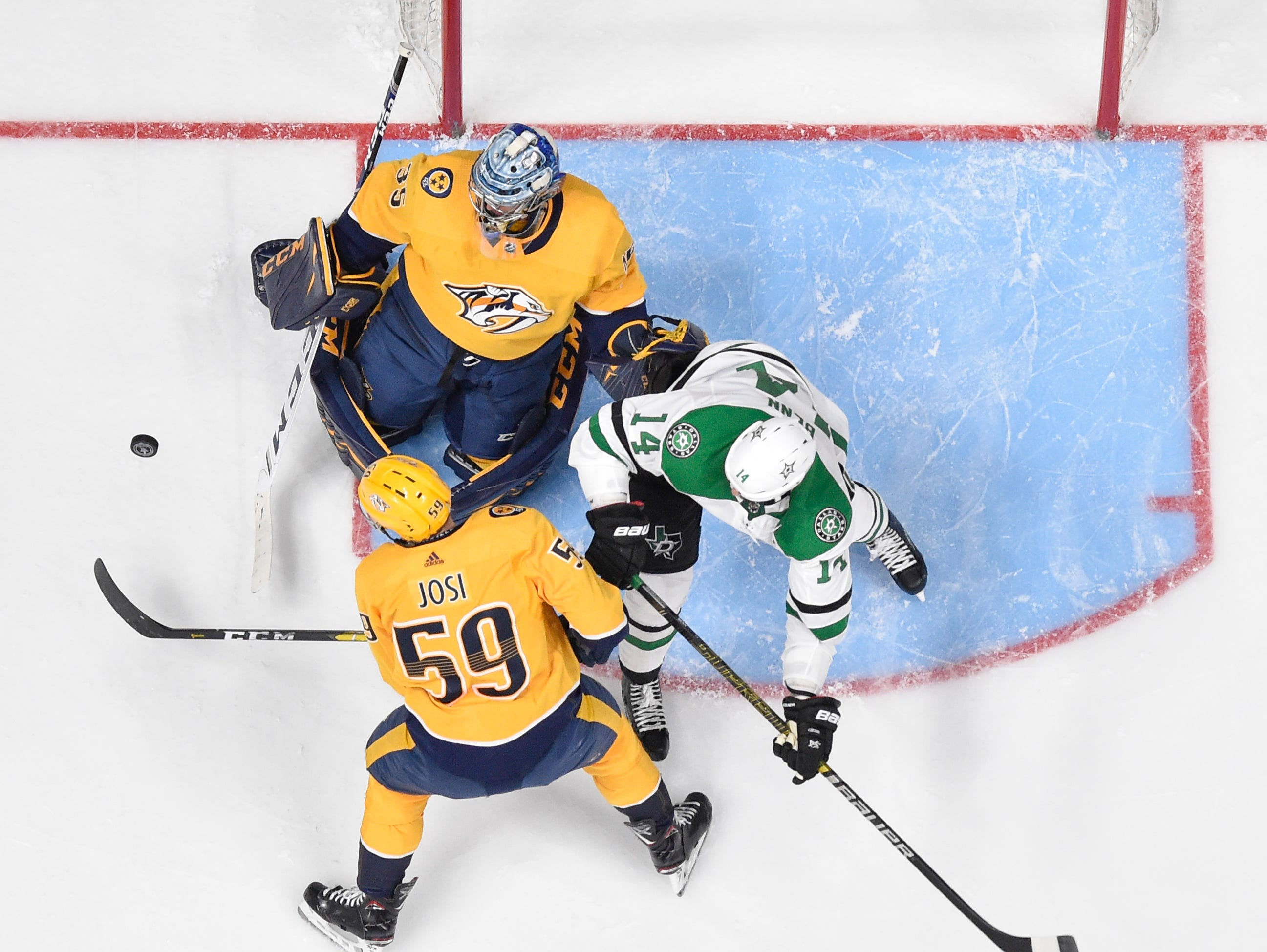 Nashville Predators goaltender Pekka Rinne (35) and defenseman Roman Josi (59) battle Dallas Stars left wing Jamie Benn (14) during the third period of the divisional semifinal game at Bridgestone Arena in Nashville, Tenn., Wednesday, April 10, 2019.