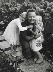 Chris Tomlin and his daughters, Ashlyn, left, and Madison