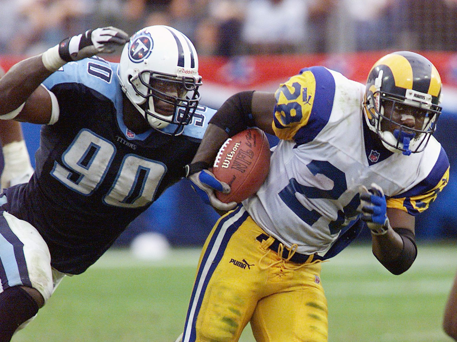 Tennessee Titans star rookie Jevon Kearse chases down Marshall Faulk of the St. Louis Rams during the Titans 24-21 victory at the Adelpha Coliseum in Nashville Oct. 31, 1999.