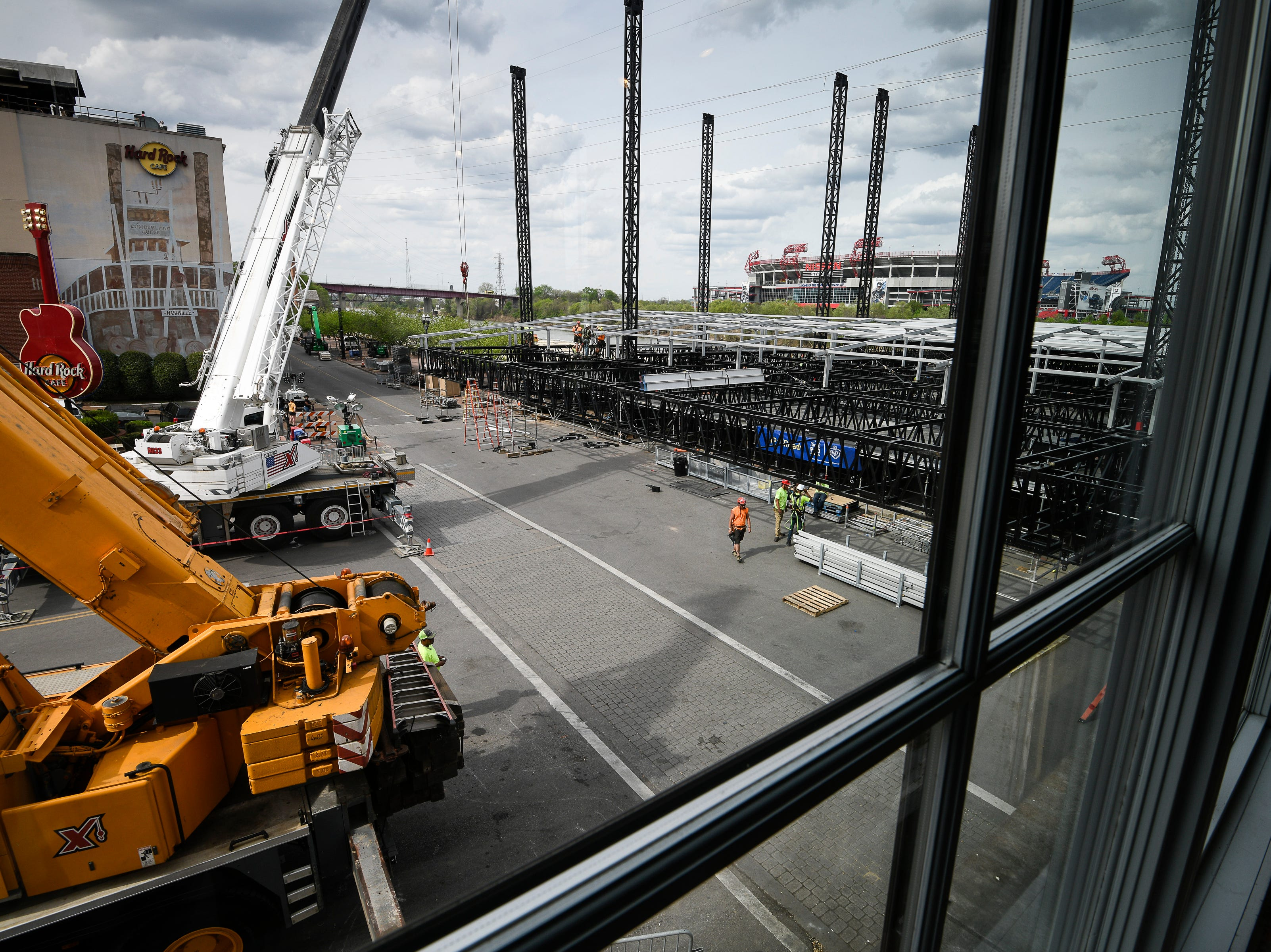 Construction continues on the NFL Draft stage at the intersection of Broadway and 1st Ave. Thursday, April 11, 2019 in Nashville, Tenn.