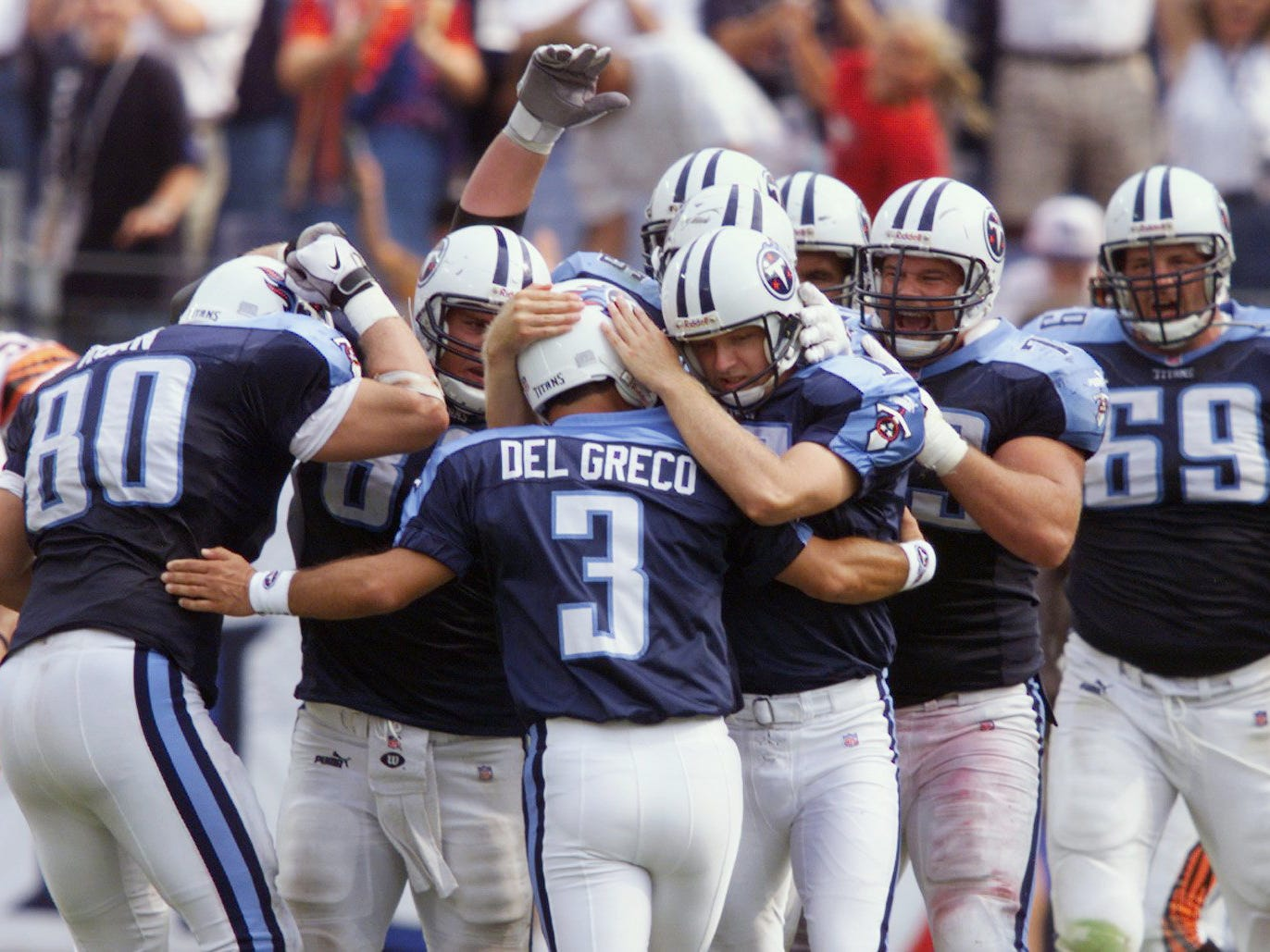 Al Del Grecco (3) is being congratulate by his teammates after making the game winning field goal at the end of their game for a 36-35 victory over Cincinnati Bengals in their home opener Sept. 12, 1999.