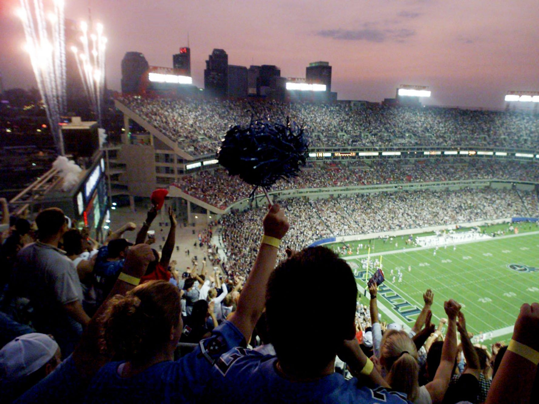 A crowd of more than 65,000 goes wild, and the fireworks soar, as the Tennessee Titans score their first touchdown in the new Adelphia Coliseum Aug. 27, 1999.  The Titans went on to defeat the Atlanta Falcons, 17-3, in their third game of the preseason and first game ever in their new stadium.
