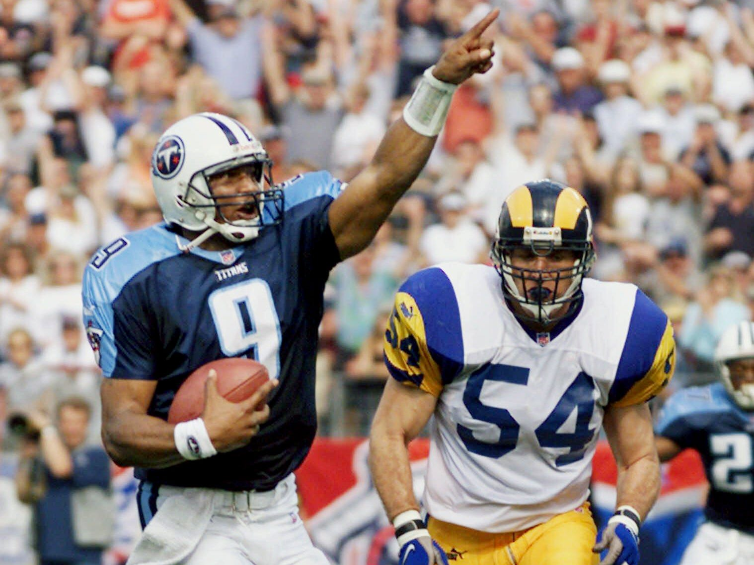 Tennessee Titans quarterback Steve McNair (9) beats St. Louis Rams linebacker Todd Collins (54) to the end zone as McNair scores a touchdown on a 10-yard-run in the first quarter Oct. 31, 1999 in Nashville. McNair is making his first start with the Titans since undergoing back surgery after the season-opening game.
