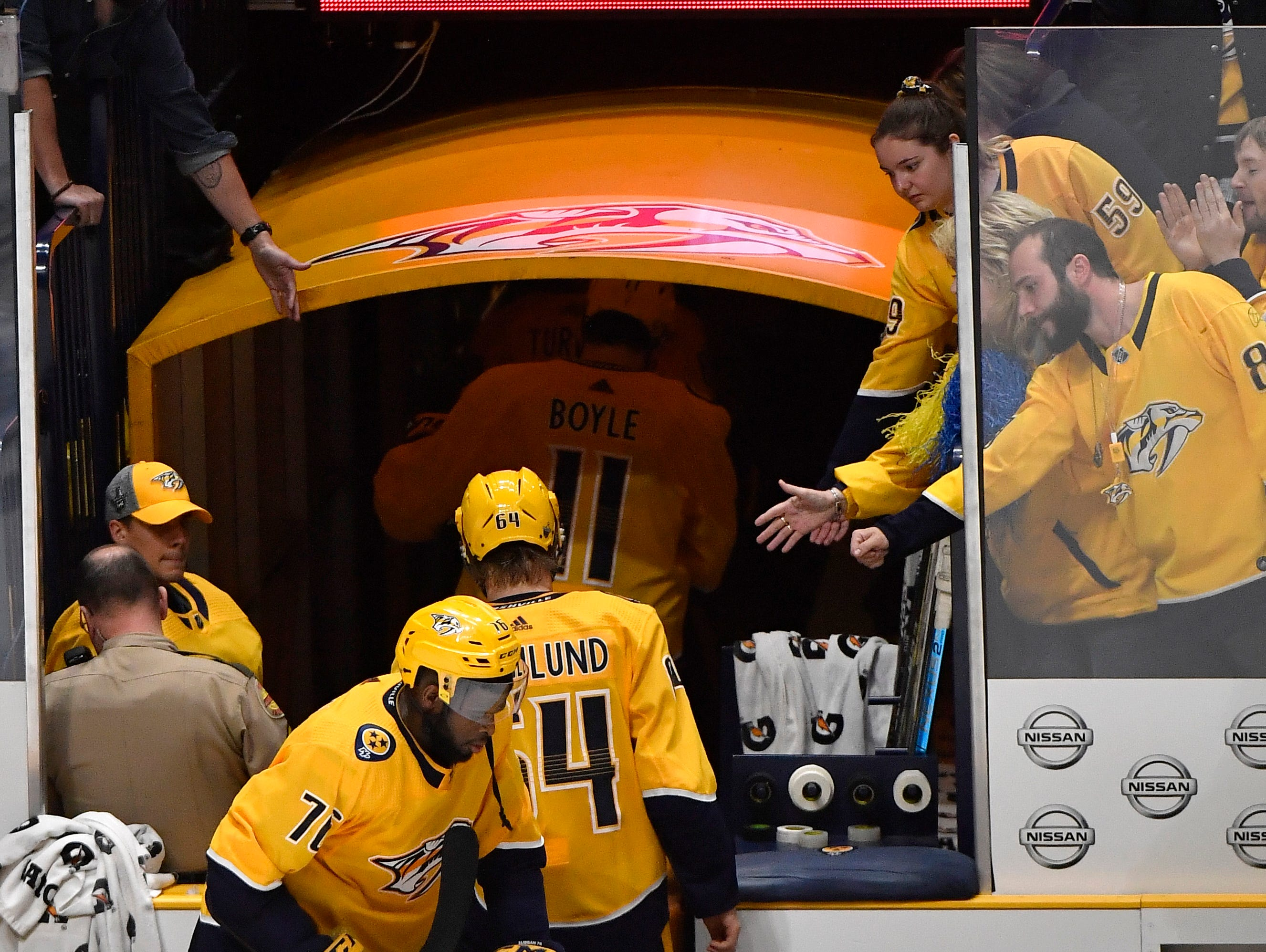 Predators fans reach for the players after they leave the ice after the team's 3-2 loss to the Dallas Stars in the divisional semifinal game at Bridgestone Arena in Nashville, Tenn., Wednesday, April 10, 2019.