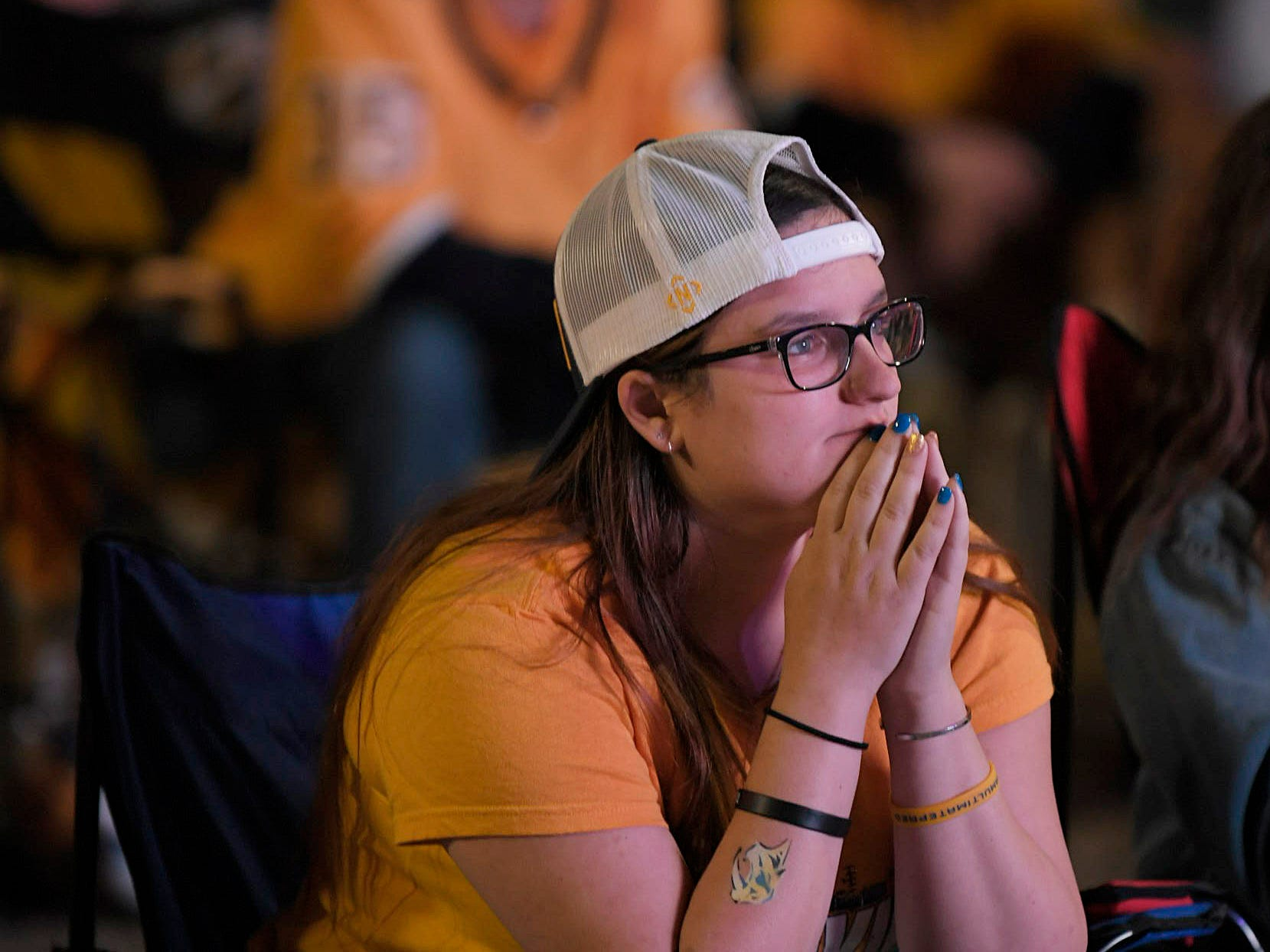 Predators fan Nicole Morosco watches the game at Preds Party in the Park at Walk of Fame Park in Nashville on Wednesday, April 10, 2019.
