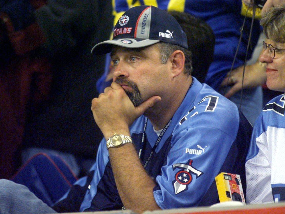 Dejected Tennessee Titans fan Montey Steene of Hendersonville sits in the Georgia Dome after the St. Louis Rams 23-16 victory in Super Bowl XXXIV Jan.30, 2000.