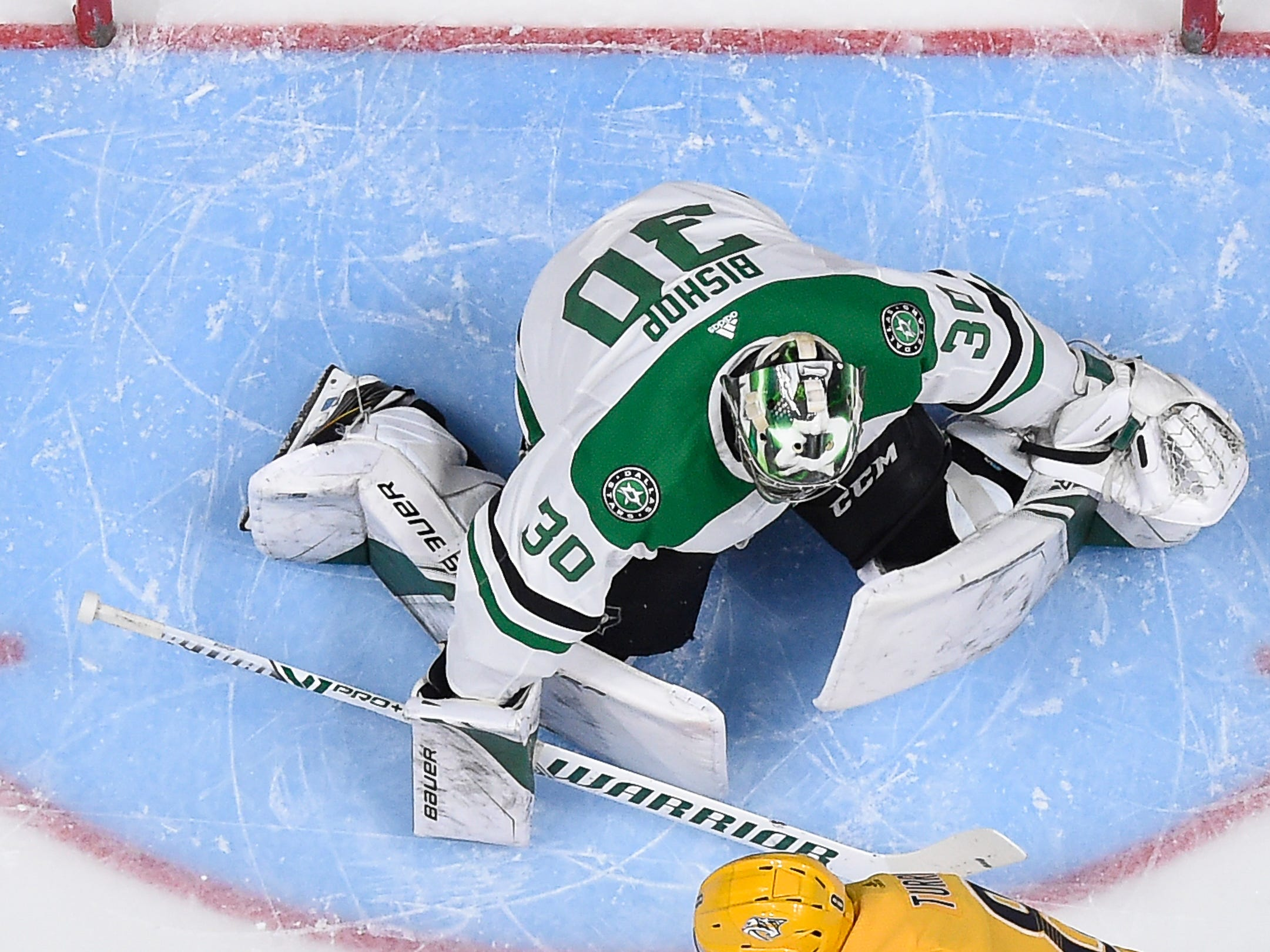 Nashville Predators center Kyle Turris (8) tries to shoot past Dallas Stars goaltender Ben Bishop (30) during the first period of the divisional semifinal game at Bridgestone Arena Wednesday, April 10, 2019 in Nashville, Tenn.