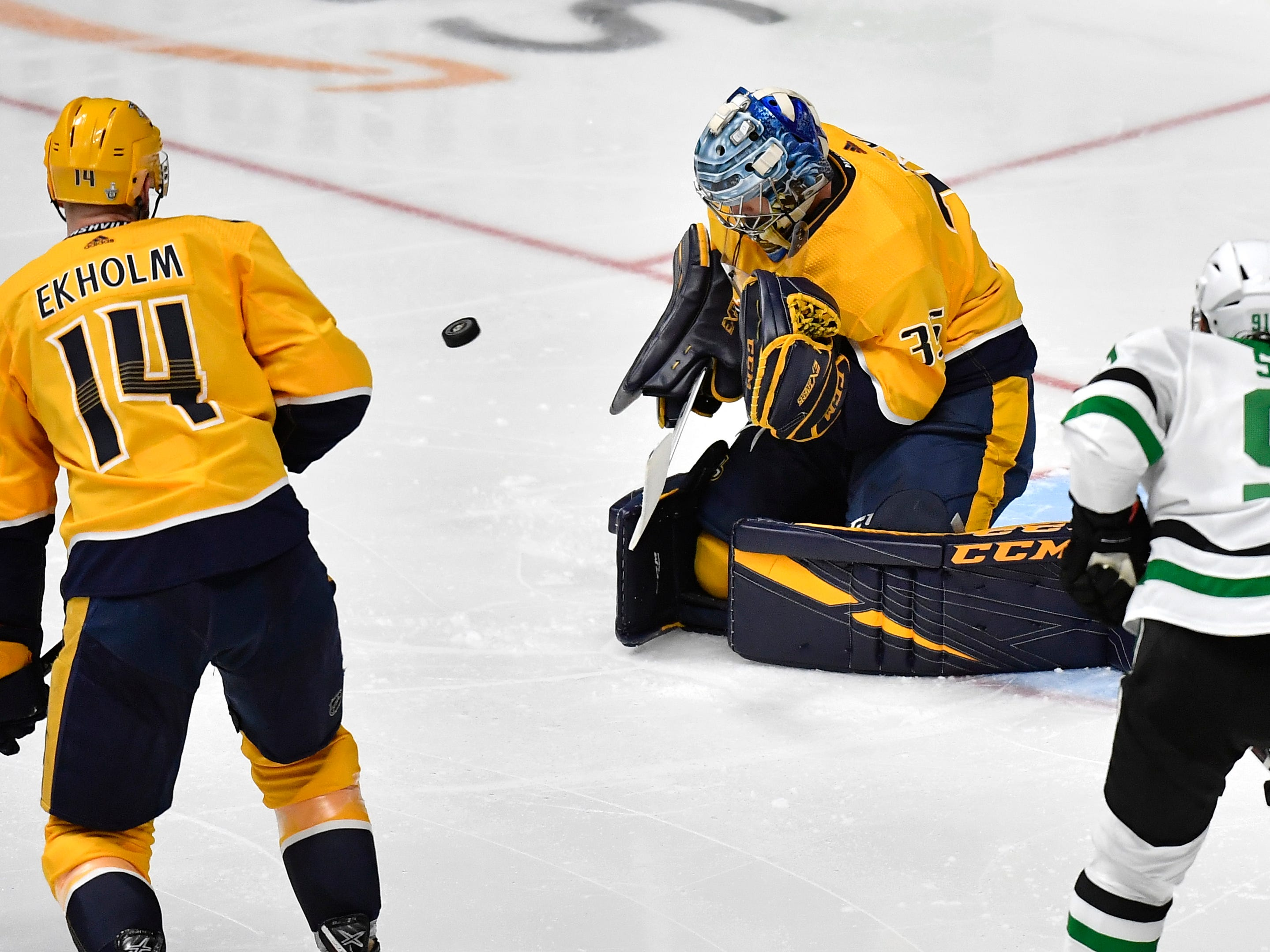 Nashville Predators goaltender Pekka Rinne (35) stops the puck during the seccond period of the divisional semifinal game against the Dallas Stars at Bridgestone Arena in Nashville, Tenn., Wednesday, April 10, 2019.