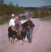 A 1975 pic of Dana Perino, then 3 years old, on a pony named Sally. Her grandparents, left, bought her the pony, and her father, Leo Perino, is on the right.