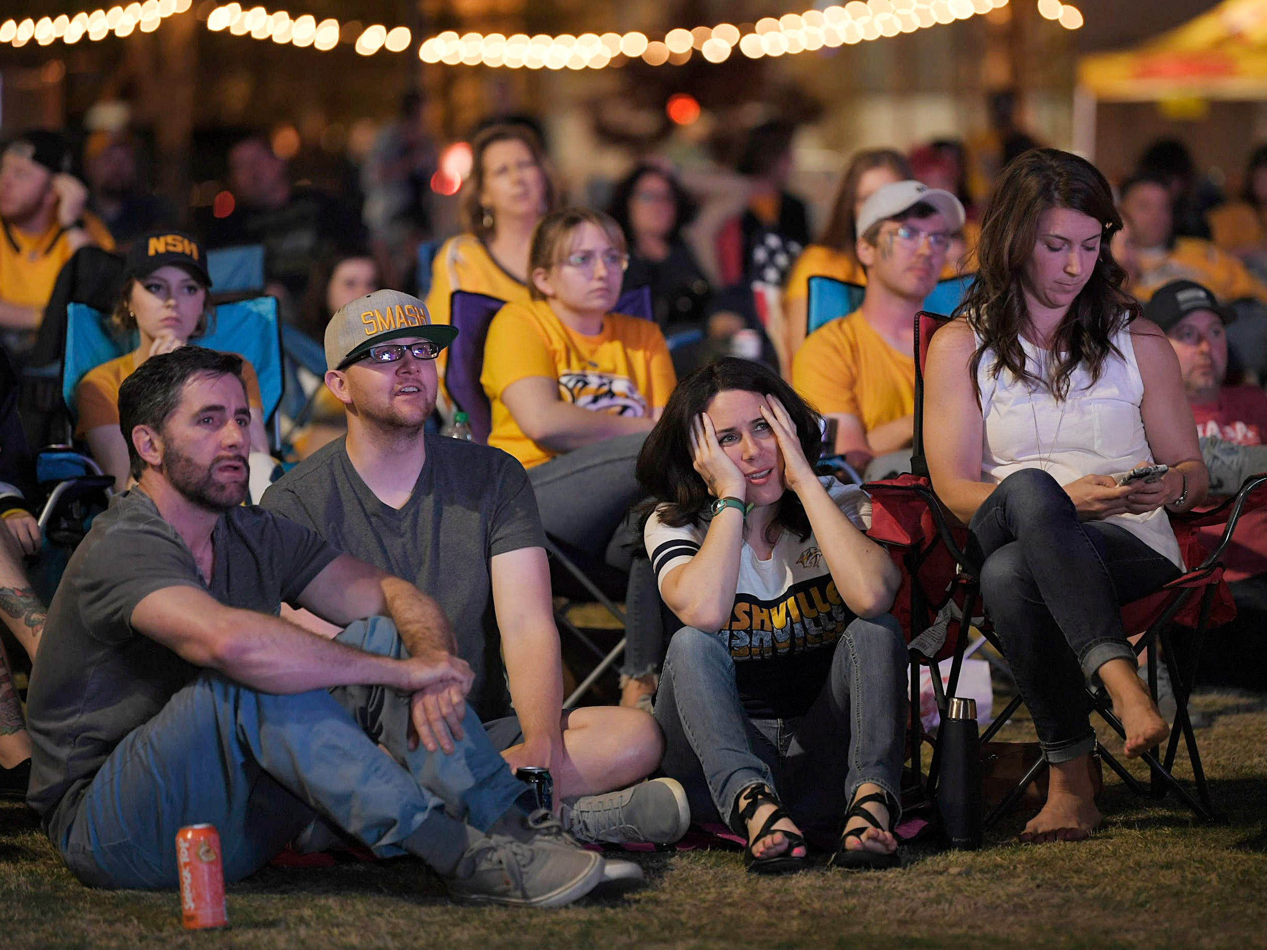 About 200 fans gather to watch the game at Preds Party in the Park at Walk of Fame Park in Nashville on Wednesday, April 10, 2019.