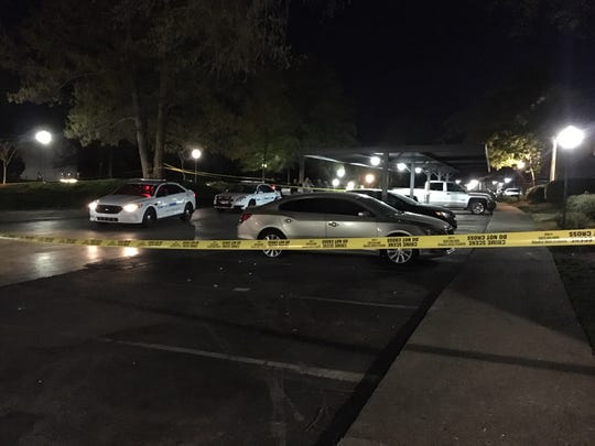 Police have taped off a large section of the parking lot outside a block of apartments in the Nashboro Village community after a shooting on Wednesday, April 10, 2019.