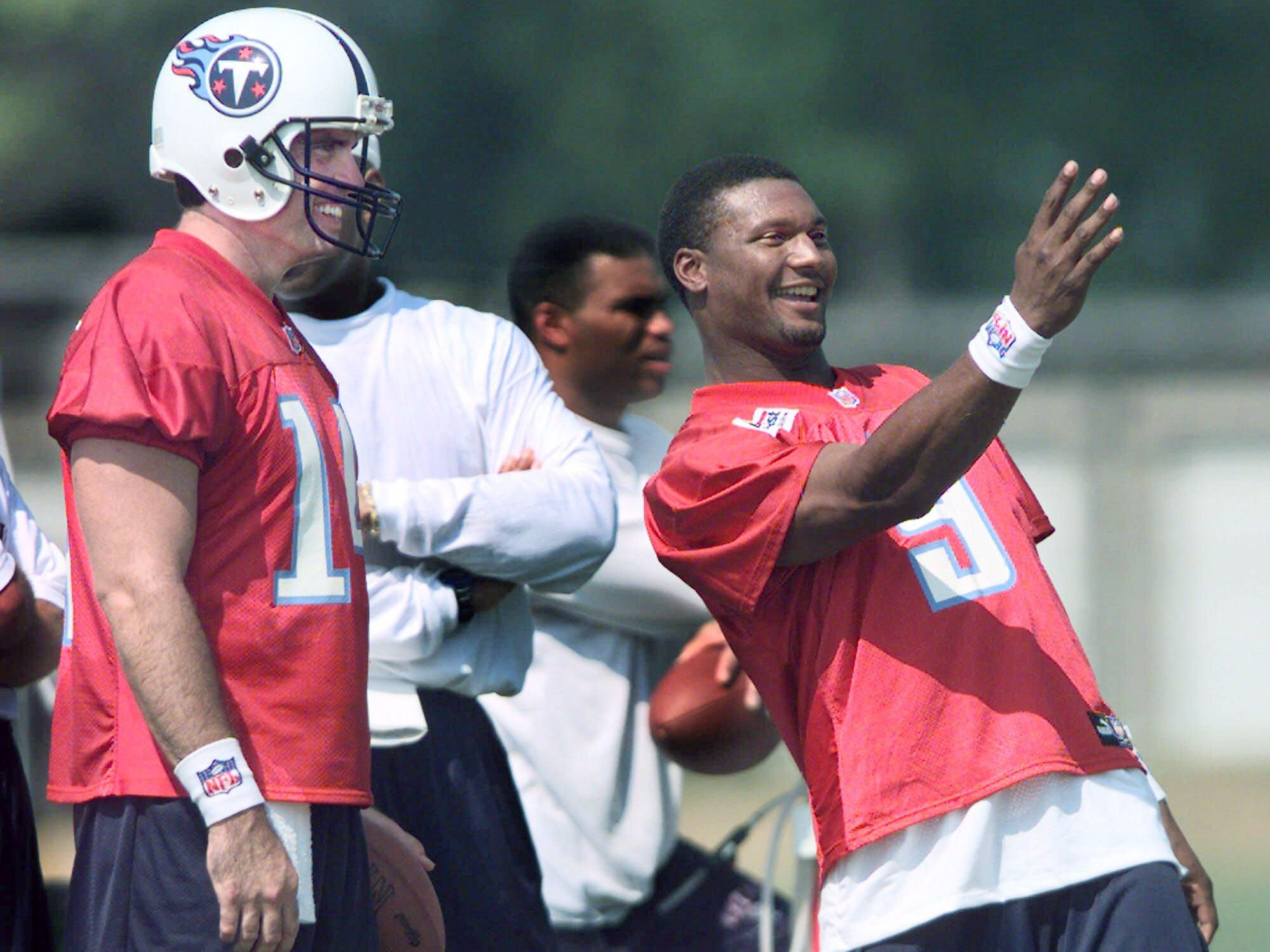 Tennessee Titans quarterback Steve McNair, right, jokes with the team's newest quarterback, veteran Neil O'Donnell, during the first day of rookie camp practice in Bellevue July 28, 1999.