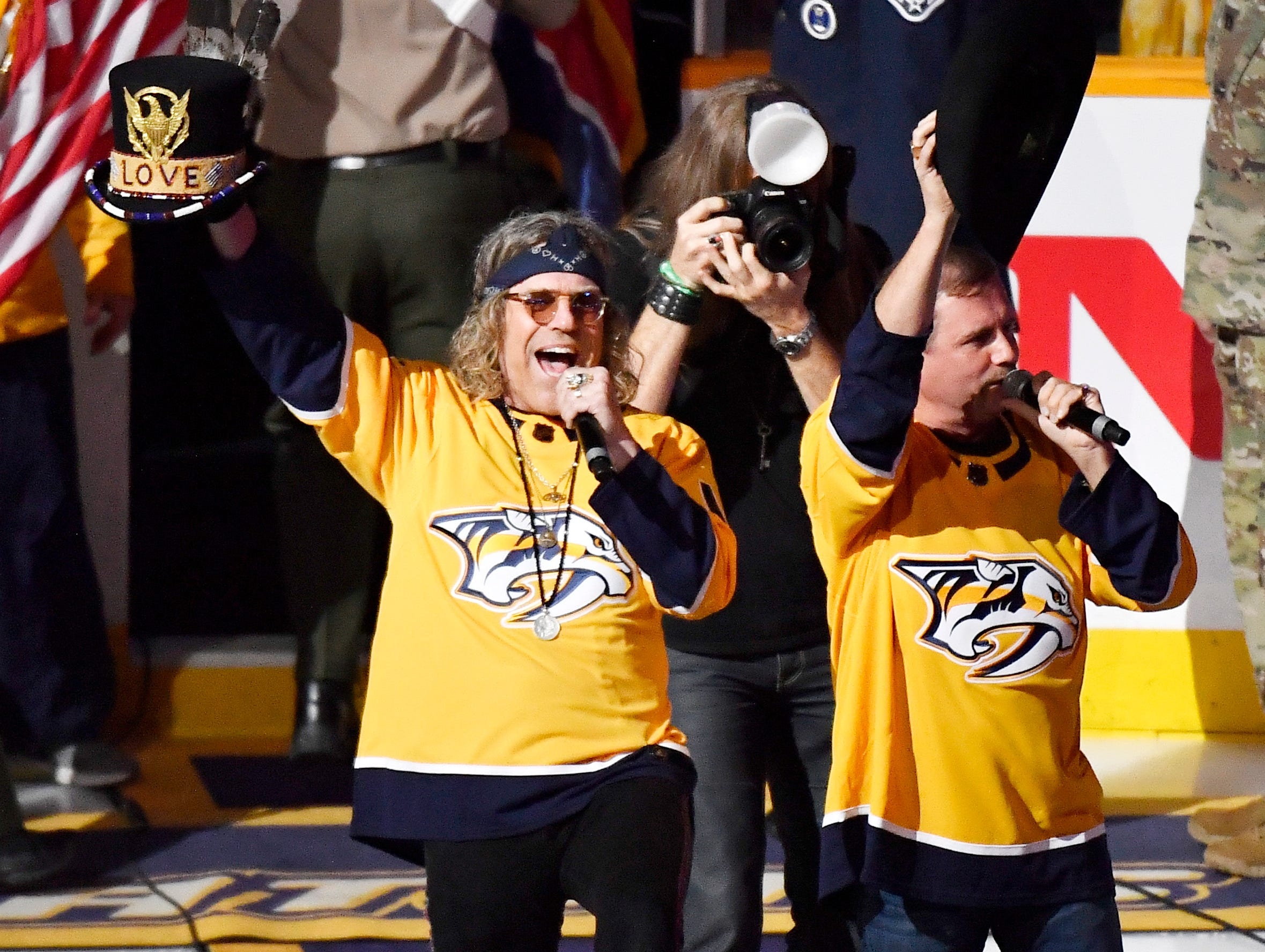 Big and Rich perform the National Anthem before the start of the Predators' divisional semifinal game against the Dallas Stars at Bridgestone Arena in Nashville, Tenn., Wednesday, April 10, 2019.