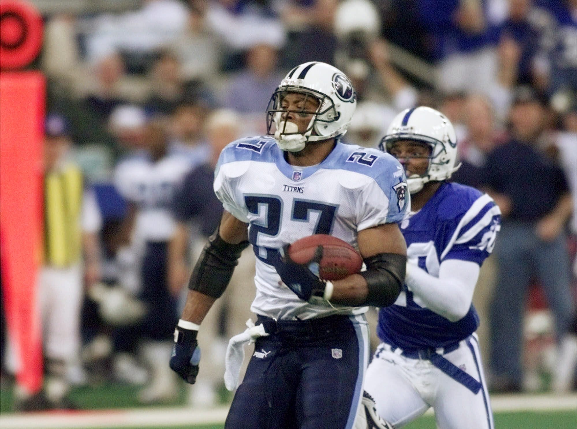 Tennessee Titans running back Eddie George, left, outruns Indianapolis Colts defensive back Jeff Burris to score a 68-yard touchdown during their 19-16 victory over the Colts in the AFC divisional playoff game at Indianapolis Jan. 16, 2000.