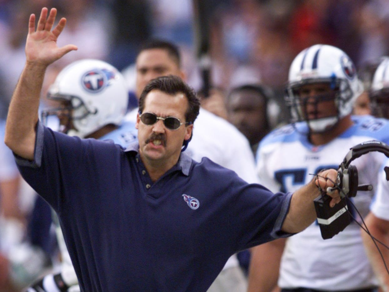Tennessee Titans head coach Jeff Fisher argues a pass inference call during their 41-14 loss to the Baltimore Ravens on the road Dec. 5, 1999.